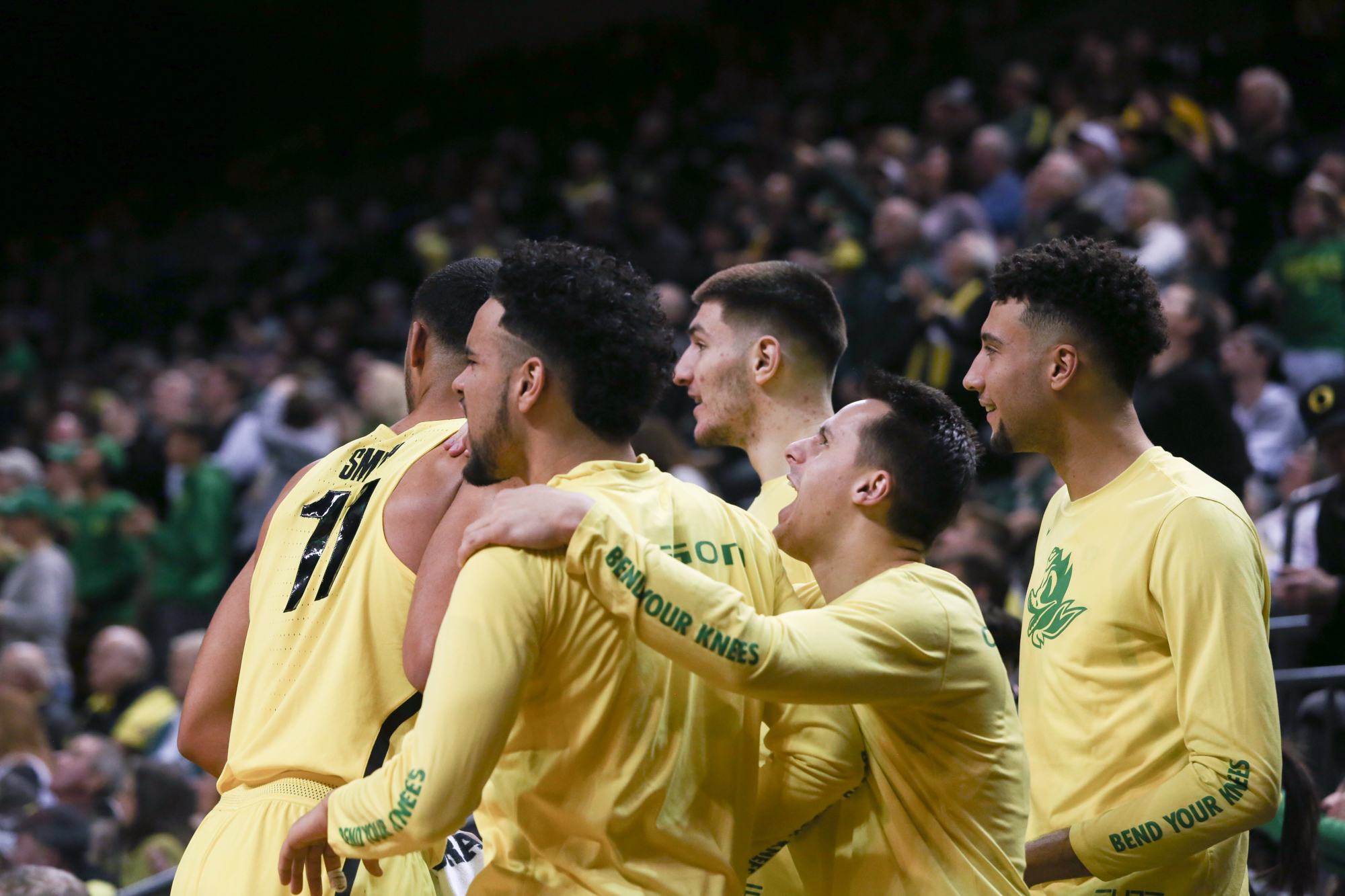 The Oregon Ducks celebrate after a score. Oregon basketball take on the Washington State Cougars at Matthew Knight Arena in Eugene, Ore. on Feb. 11, 2018. (Natalie Waitt-Gibson/Emerald)