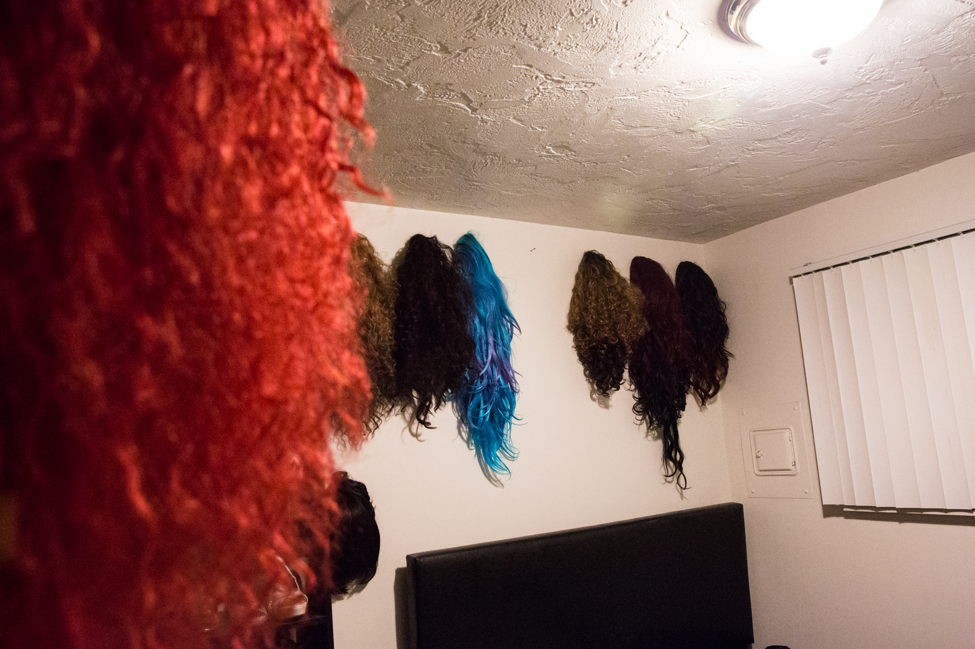 Nicky Serene's many wigs are displayed on the walls of Mark Harbaugh's drag room. Mark's choice of wig for the Glamazons show depends on the song choice, outfit and mood of the evening.
