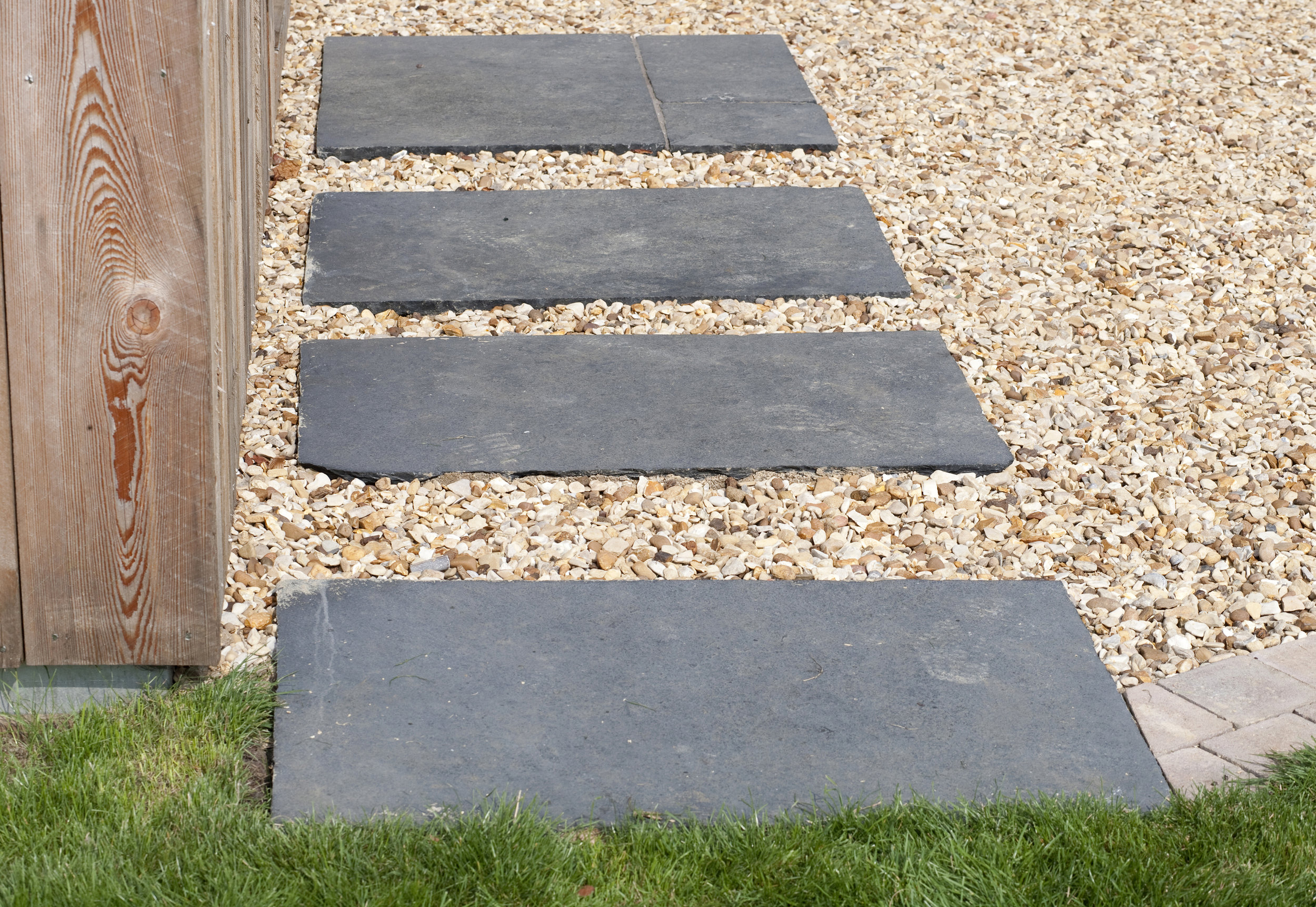 Stepping stones made of Indian slate are a stunning way to create contrasting colour and texture for Nicola's garden walkway.