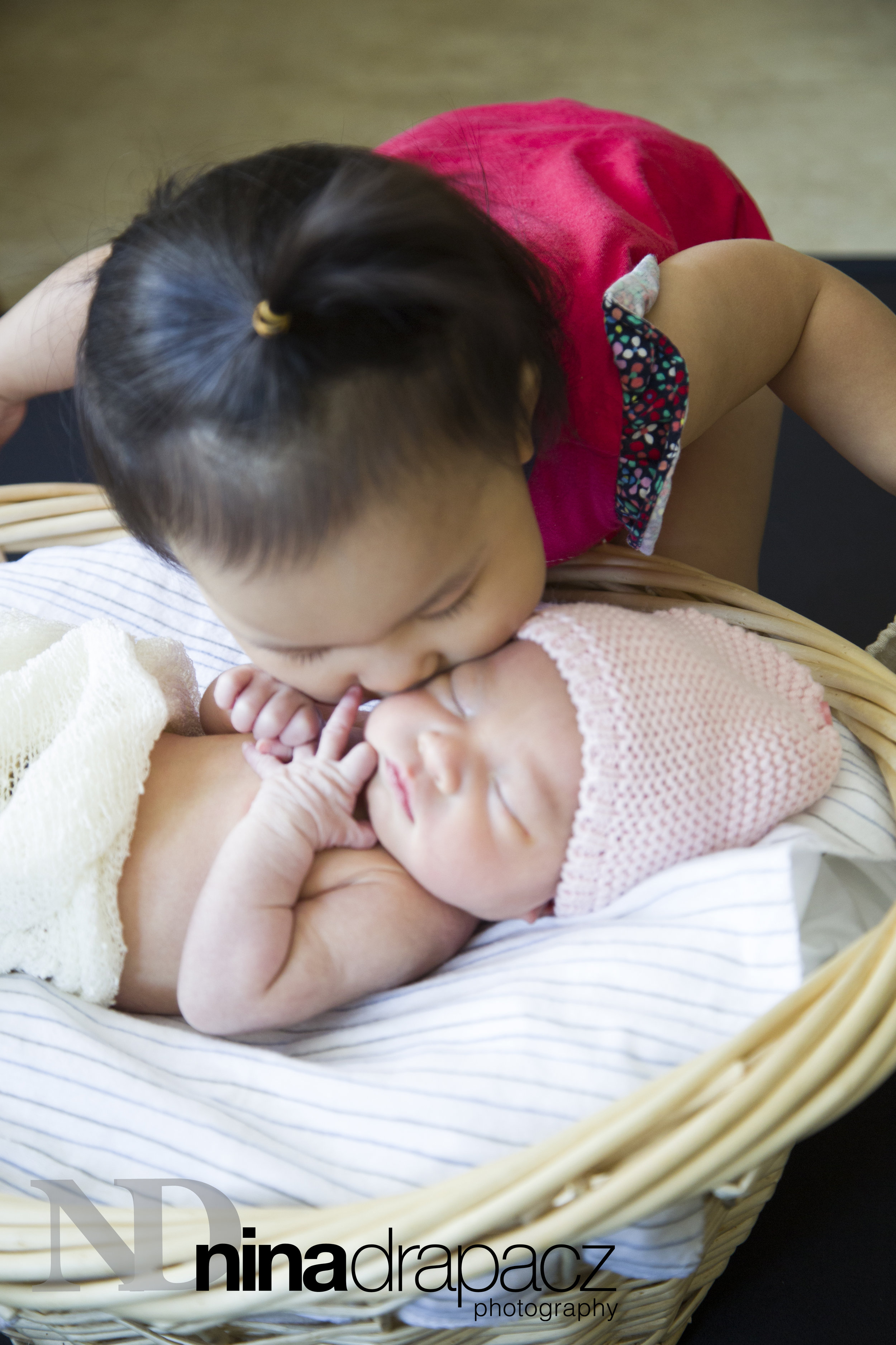 newbornwithsister.jpg