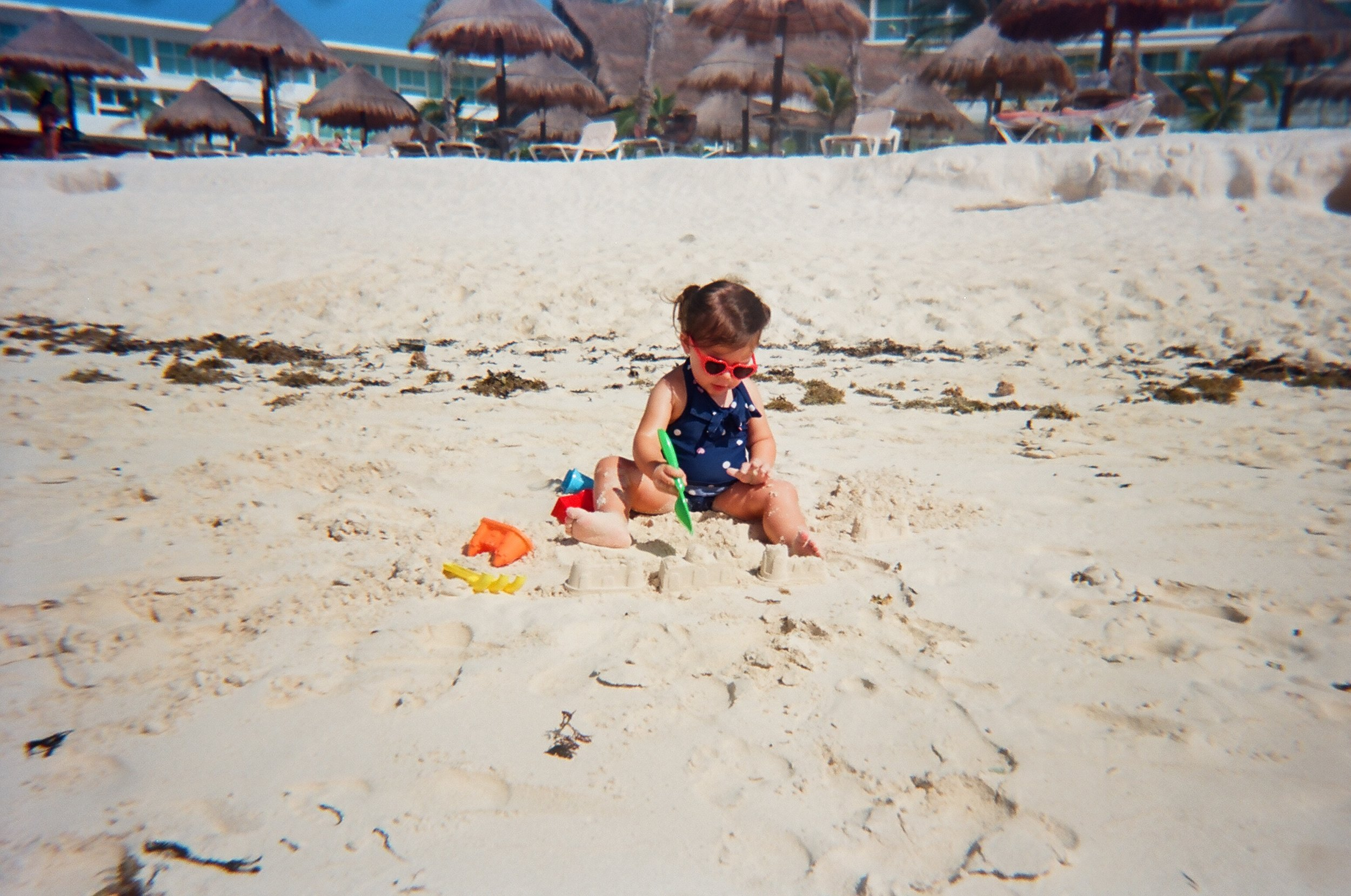 playing in the sand in Cancun