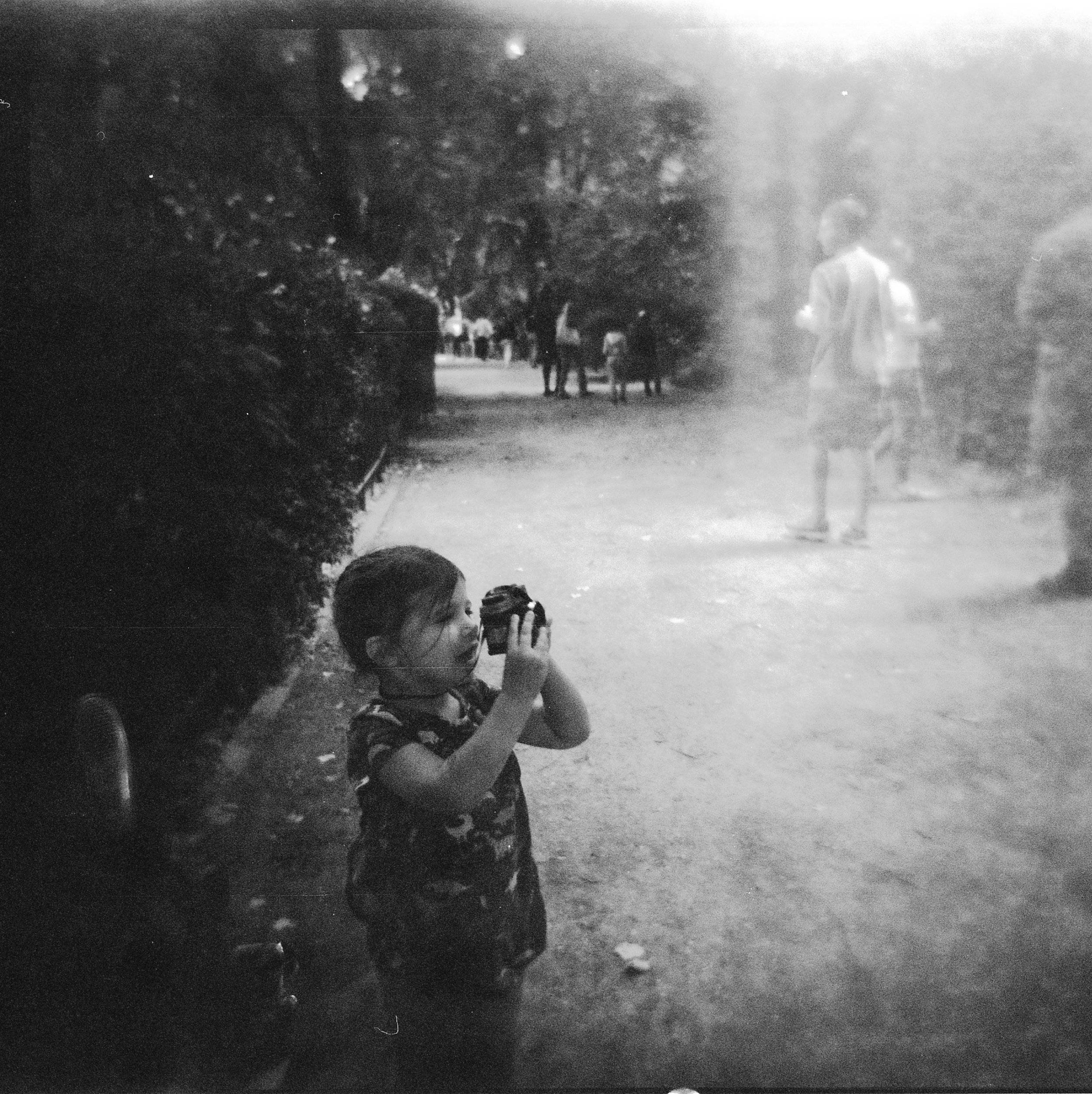 toddler taking a film photo, 120mm film