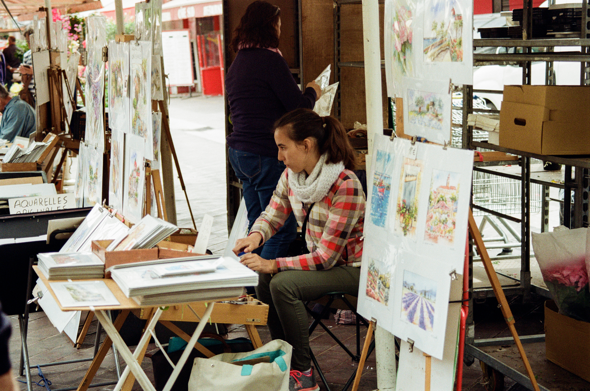 artist selling prints at Cours Saleya market  in Nice