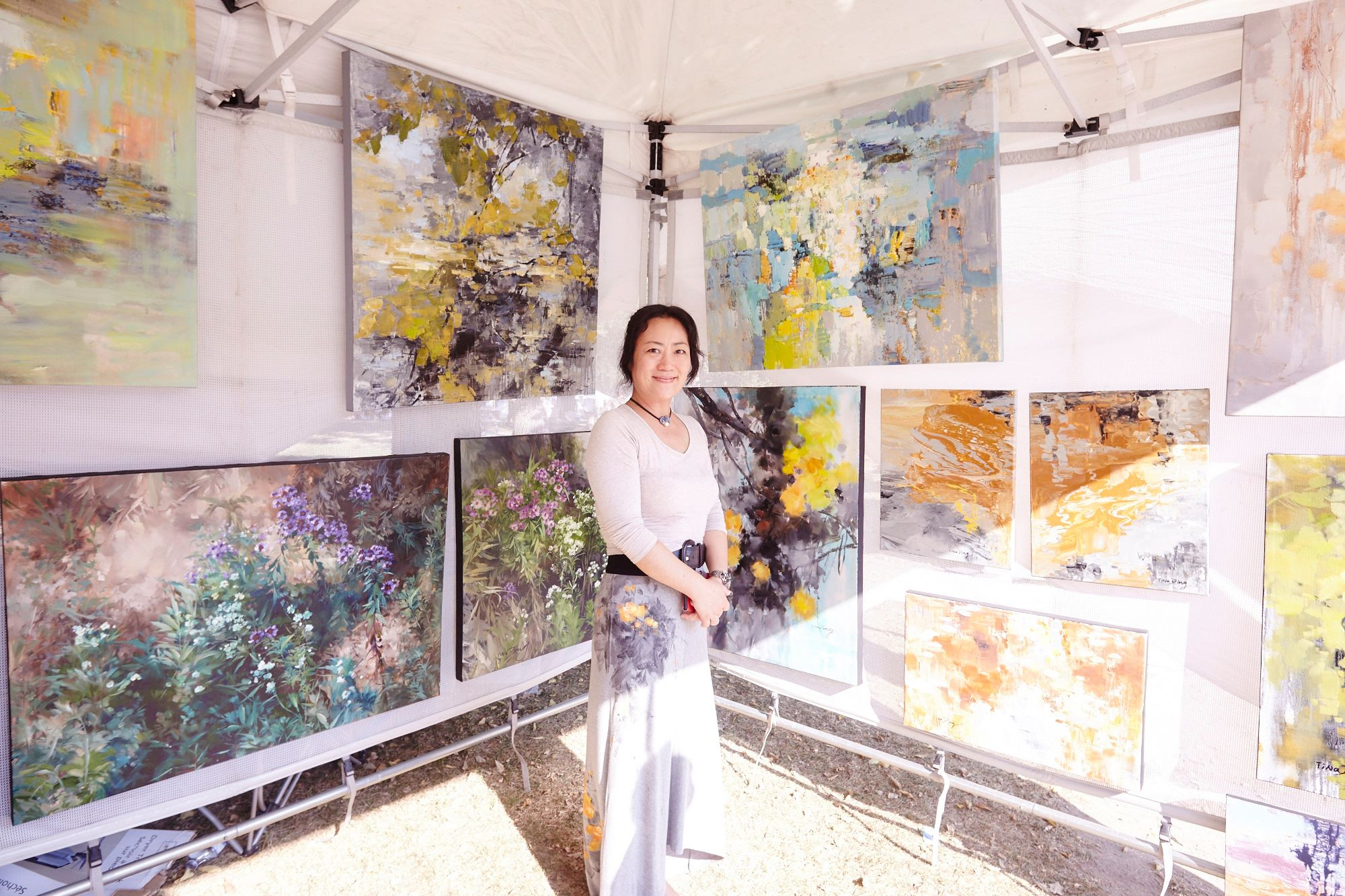 An artist in her booth at the 2017 Queen West Art Crawl.