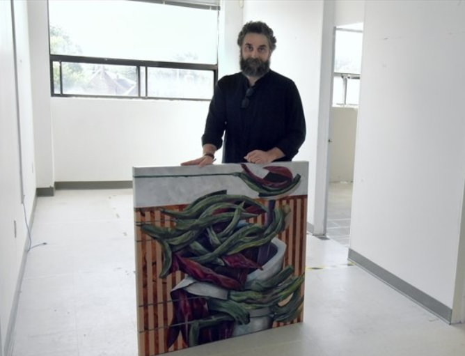 Akin Collective studio co-ordinator and artist Soroush Dabiri displays one of his pieces inside one of the studio spaces at the new Akin Lakeshore location in Lakeshore Village. The artist studios and shared workspaces is set to open in September. - Staff/Torstar