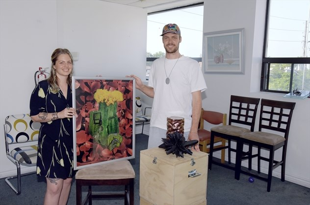 Two artists standing with artwork in an Akin Collective art studio at Akin Lakeshore in South Etobicoke. Affordable art studios for rent in Toronto.