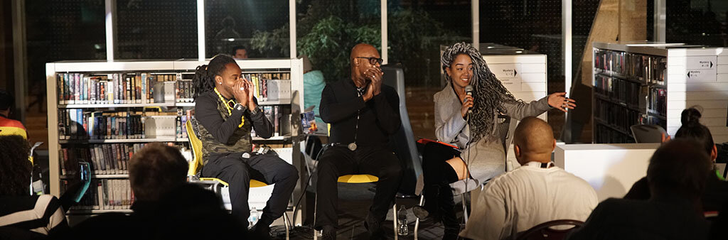 Panelists Sokrates, Cameron Bailey, and Amanda Parris at a Nuit Talks 2018 event at the Scarborough Civic Centre Library in 2018. Anthony Gebrehiwot