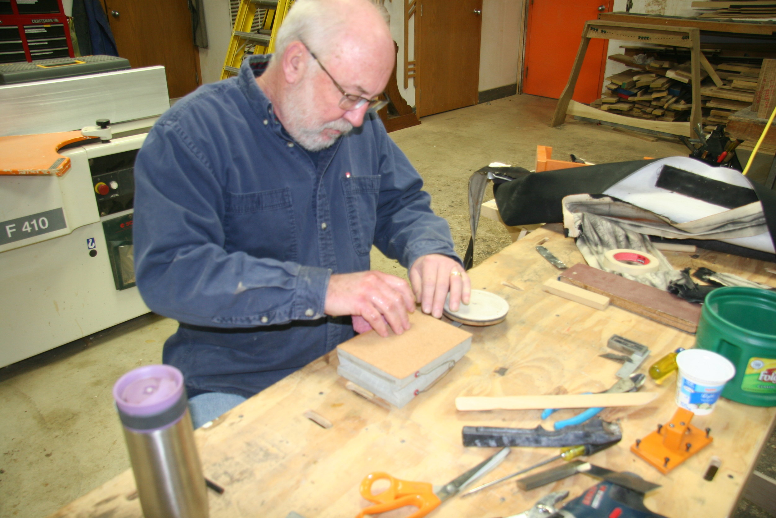 Dale rebuilding small wedge pneumatic for tremulant cutout.