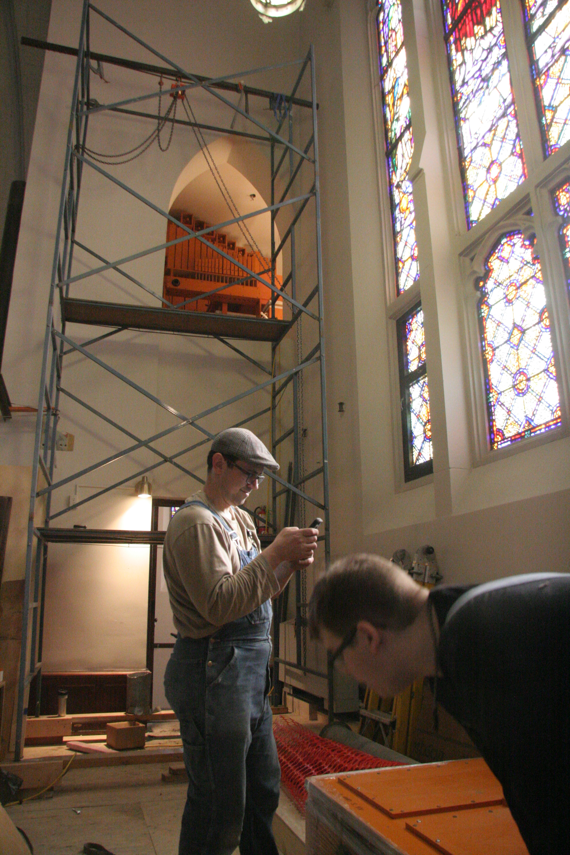 Donald Nordlie and Joe Brown with background showing pedal chamber and scaffolding.