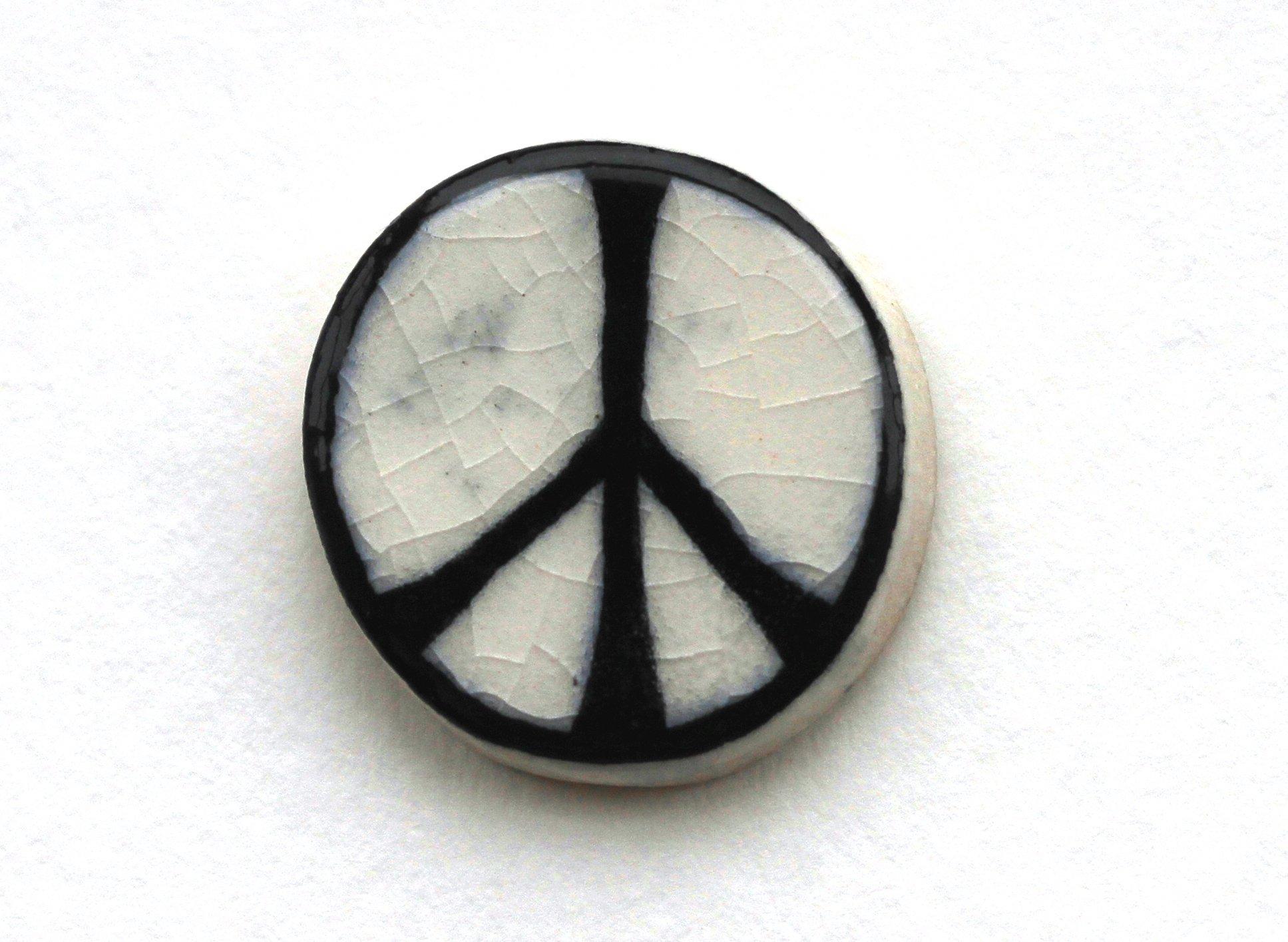 An original CND ceramic badge via http://www.cnduk.org/about/item/435-the-cnd-symbol