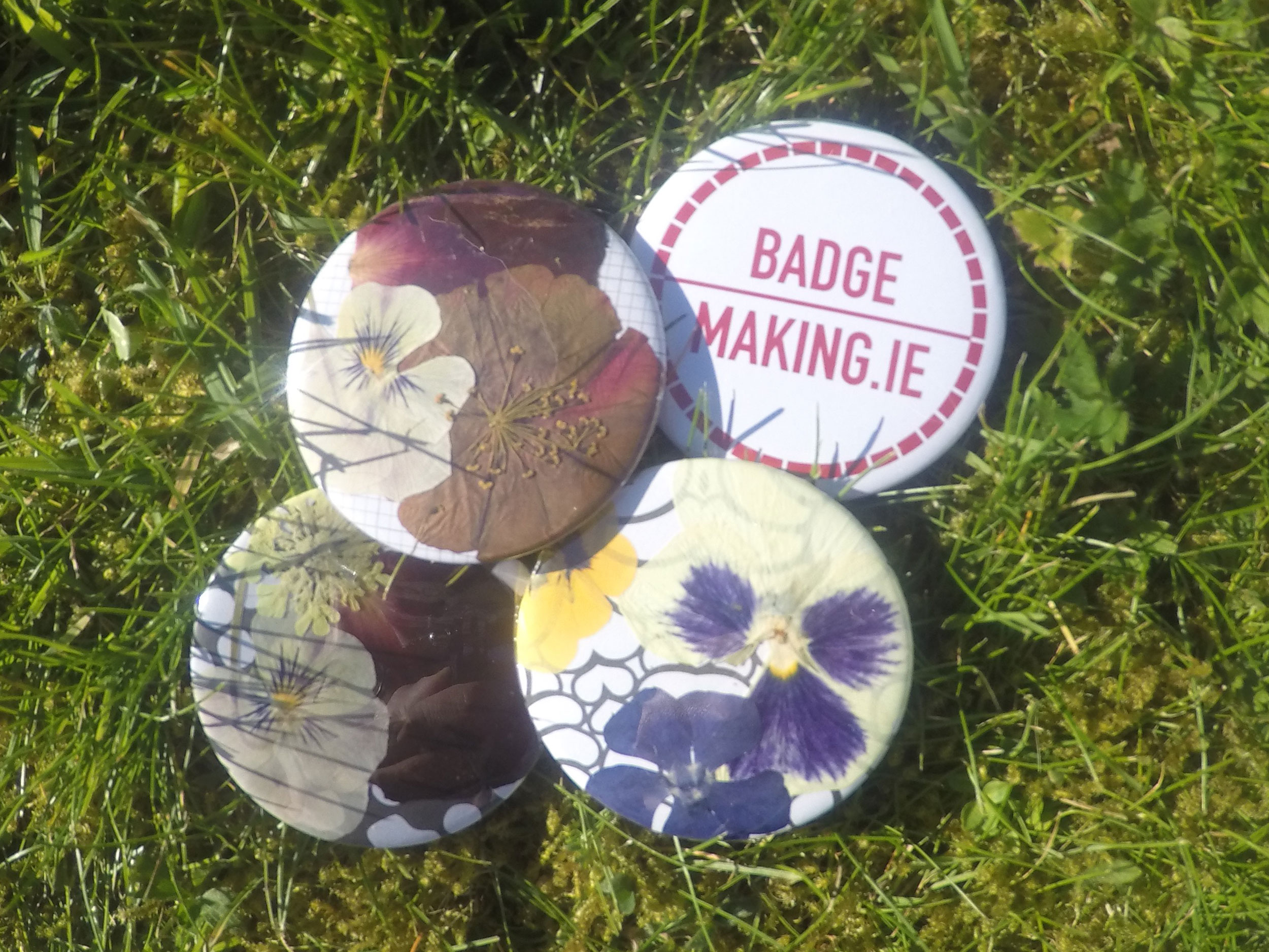 Badges made with pressed flowers