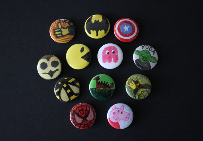 Some hand drawn badges from a family fun day