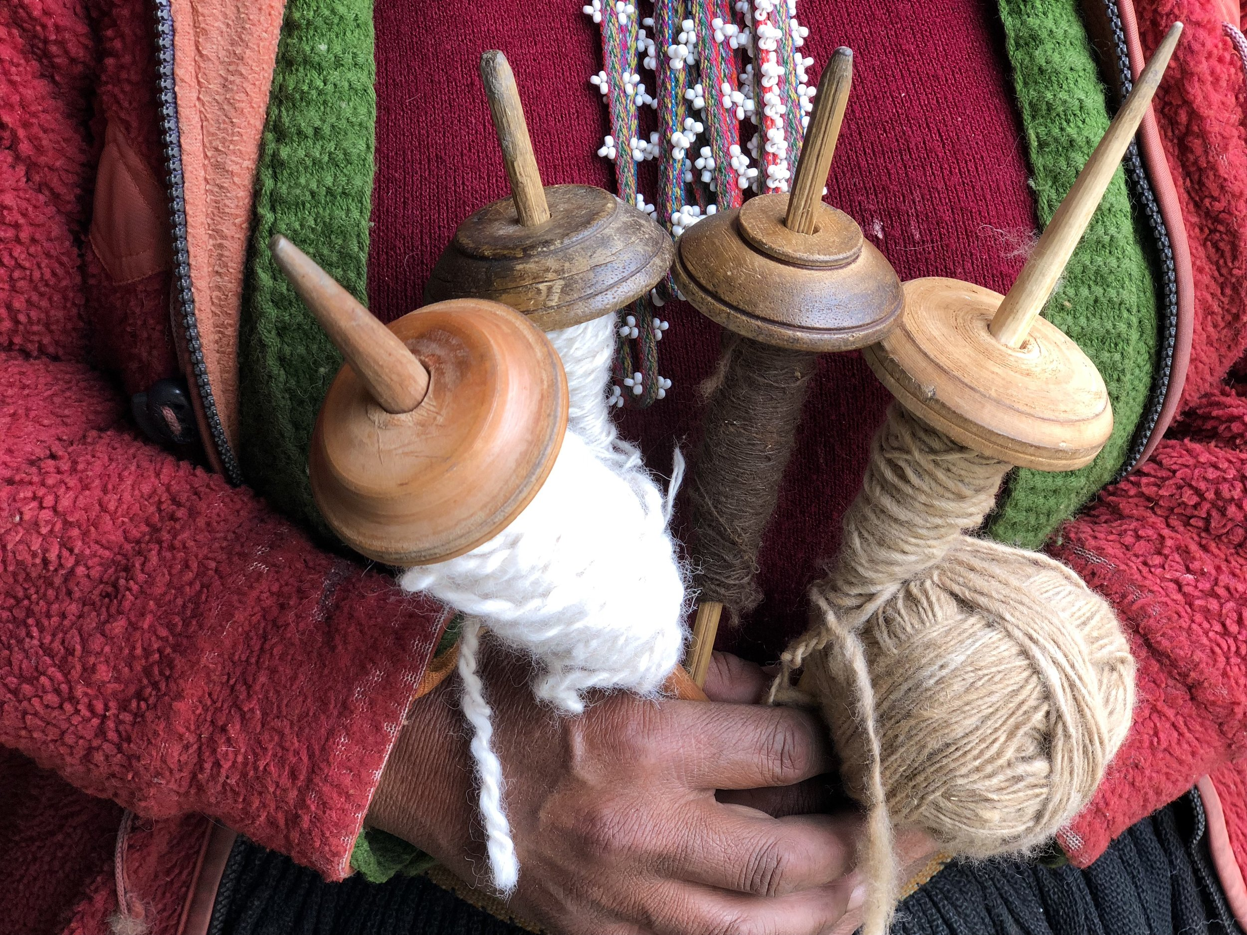 A tool called a puska, is used to spin the raw fiber into yarn.