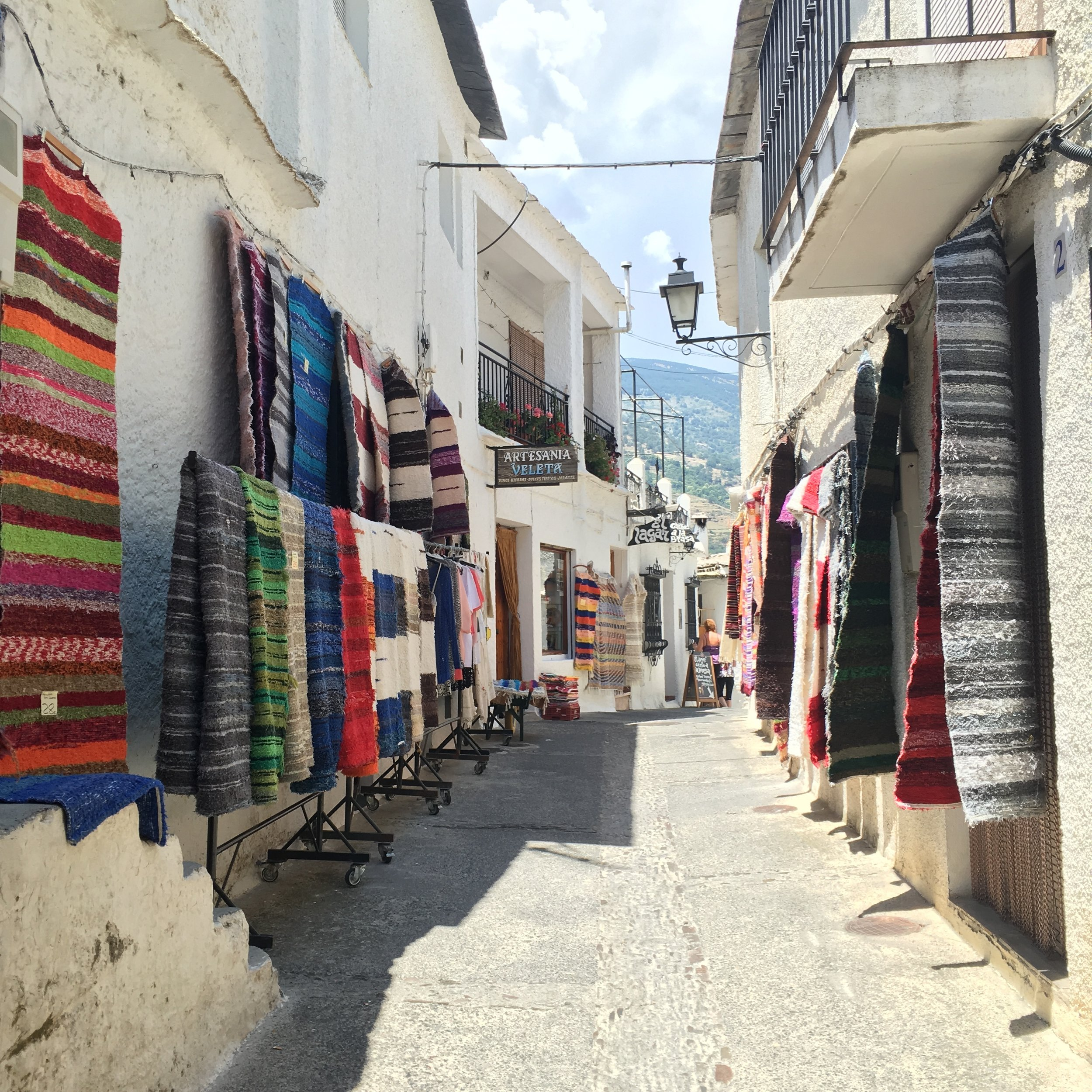 A typical street in the little town of Pampaneira, Spain, which is one of three mountain villages of the Barronco poqueira in the Alpujarras region in the province of Granada.