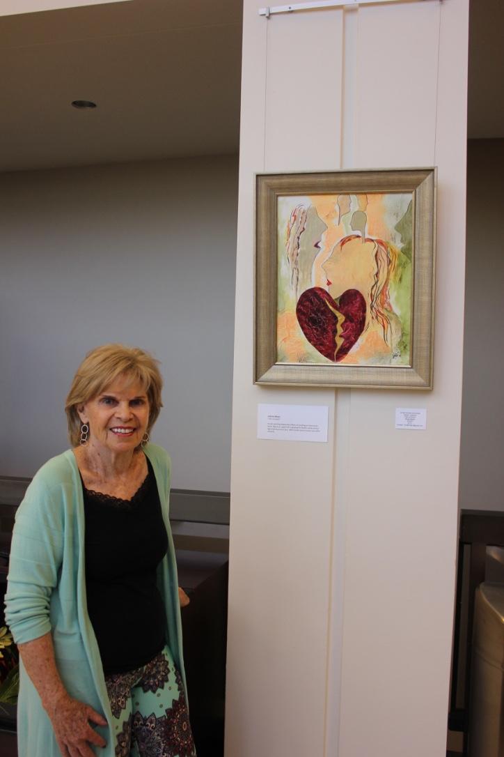 "Joanne Allison with her art piece ""Life Cut Short"""