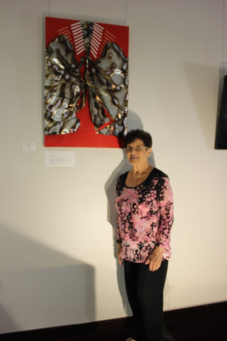 """Raquel Rub with her art piece """"The pleasure of smoking... does not preview the outcome!"""""""