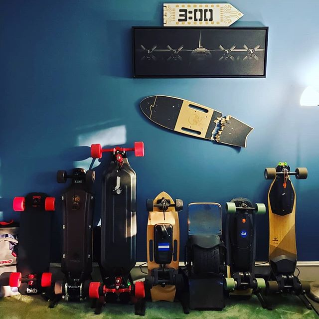 My wall of rideable happiness #esk8 left to right #bkb #hoytst  #metroboard #rideriptide #onewheel #boostedminix #boostedv2 @hoytskate @metroboards @buildkitboards @rideriptide @onewheel @boostedboards