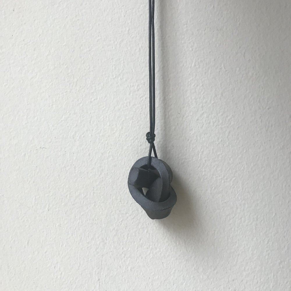 "MINI UNION KNOT | CHARCOAL  ceramic knot on leather cord approx. 2""L, 1.5""H, 1""W (varies) $20 Wholesale 