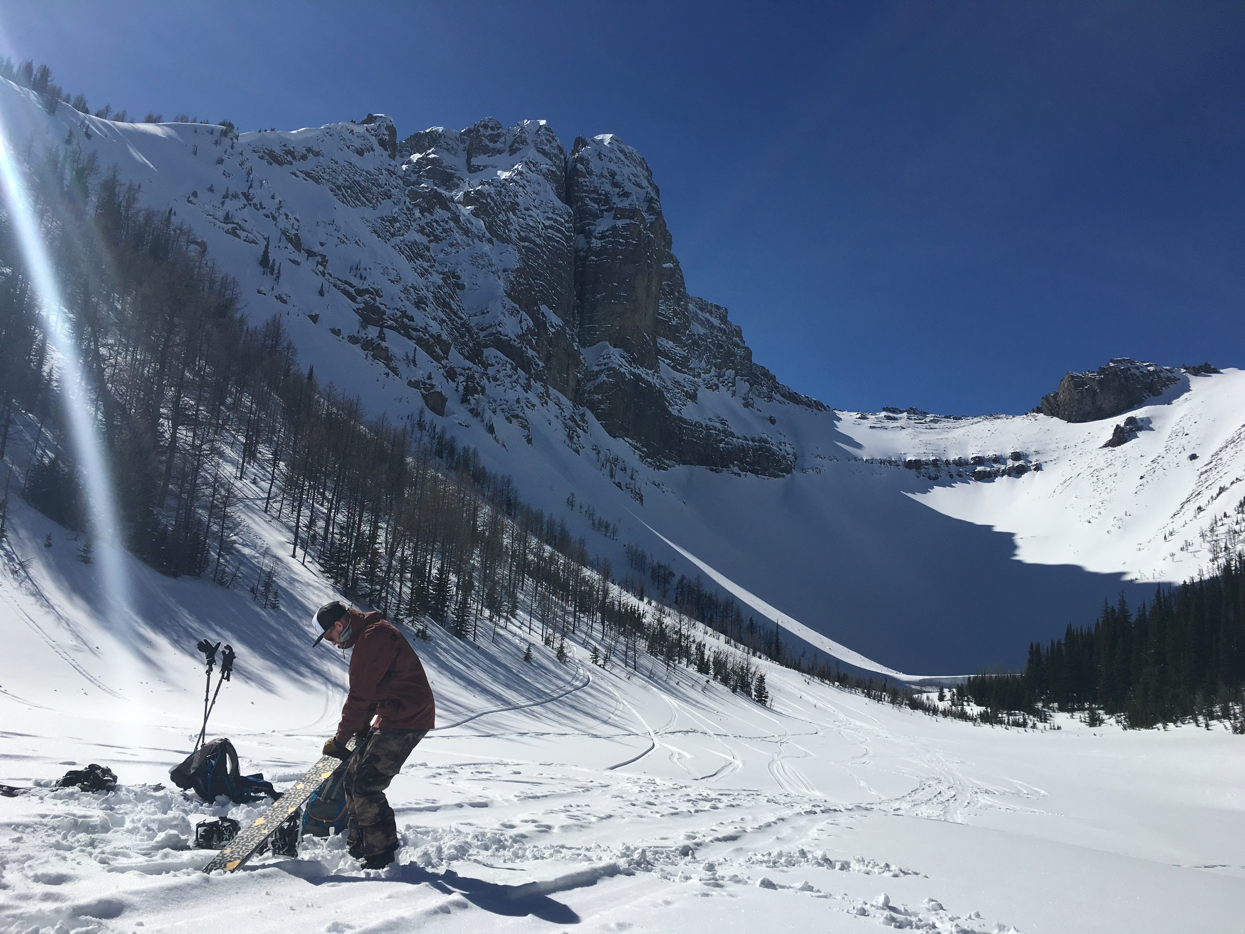 Laying the skins back down on Tryst Lake  Kananaskis Country    Photo: Zach