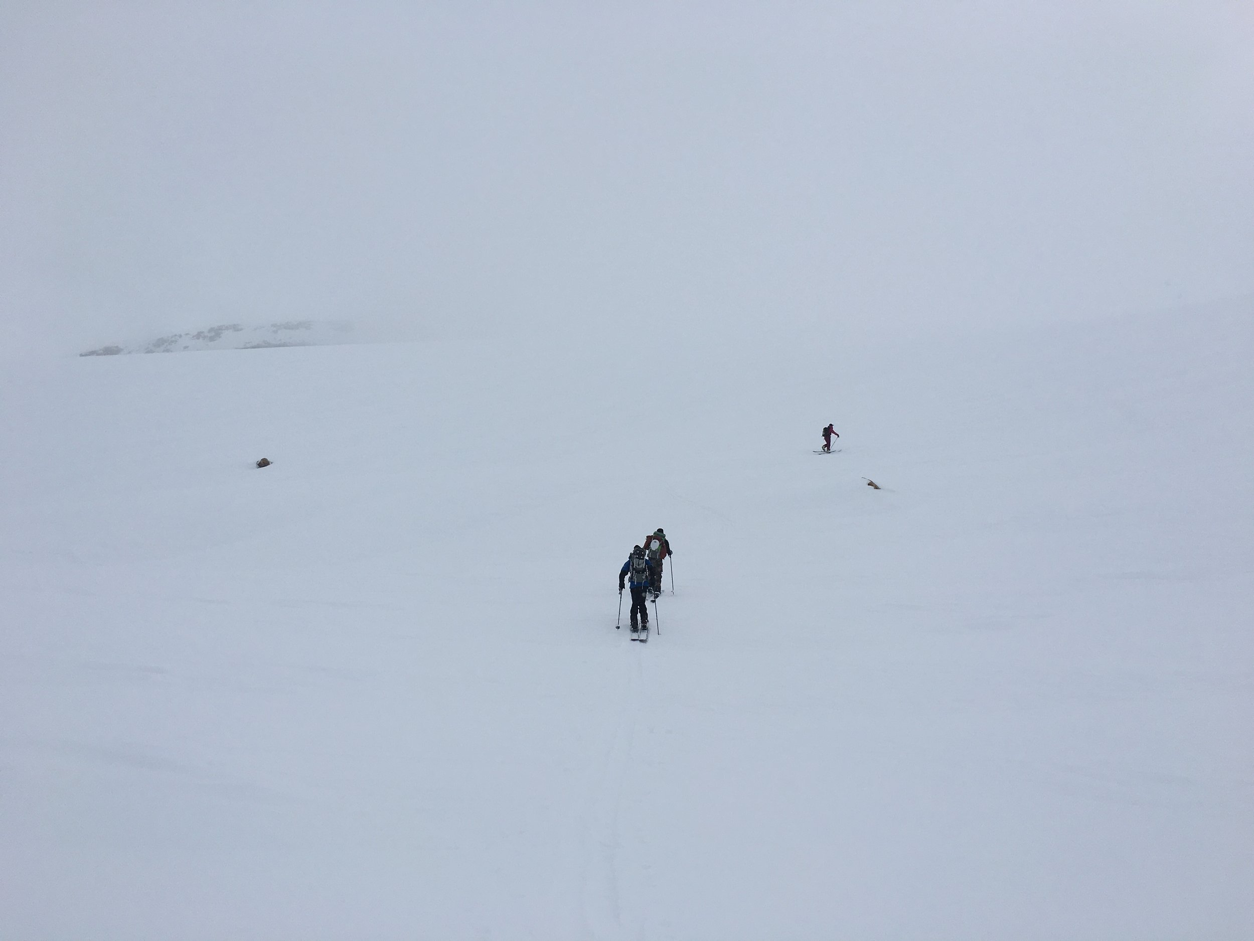 Heading up Young Peak in straight whiteout conditions  Photo:Zach Husted