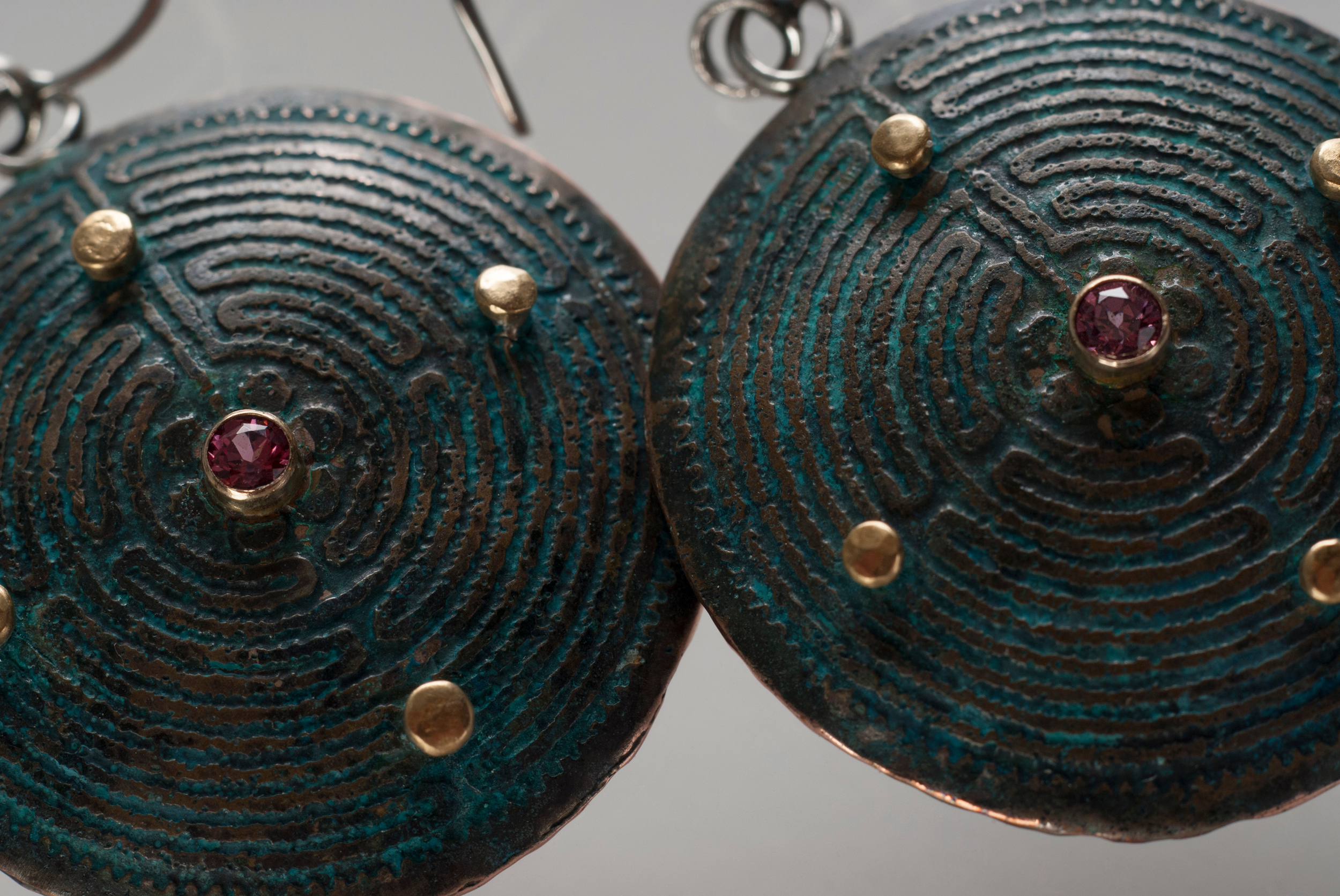 Etched shibuichi earrings with 18kt gold and garnets.