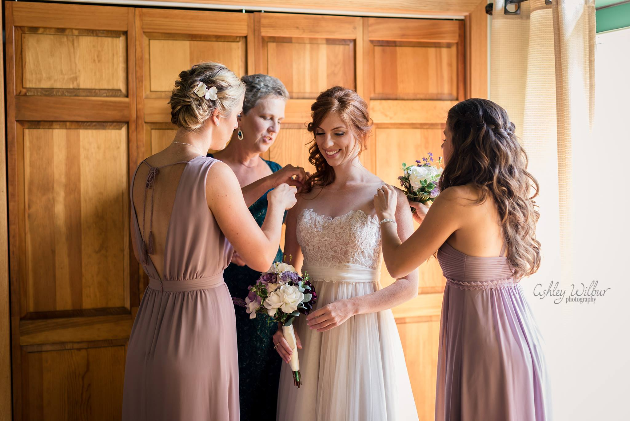 Bride getting in her wedding gown - Saratoga Lake, NY Wedding