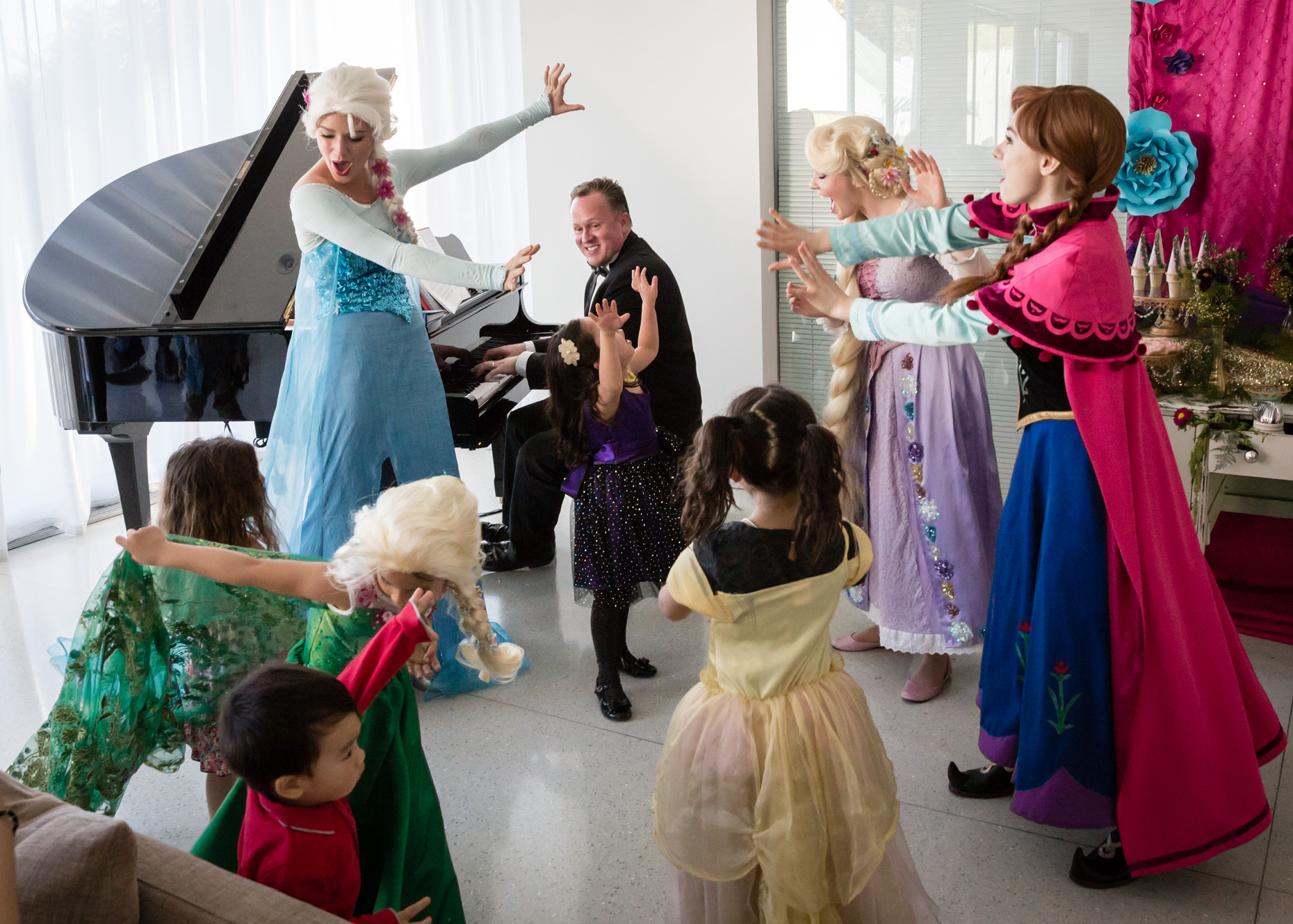 elsa anna rapunzel sing let it go chris ring pianist beverly hills party.jpg