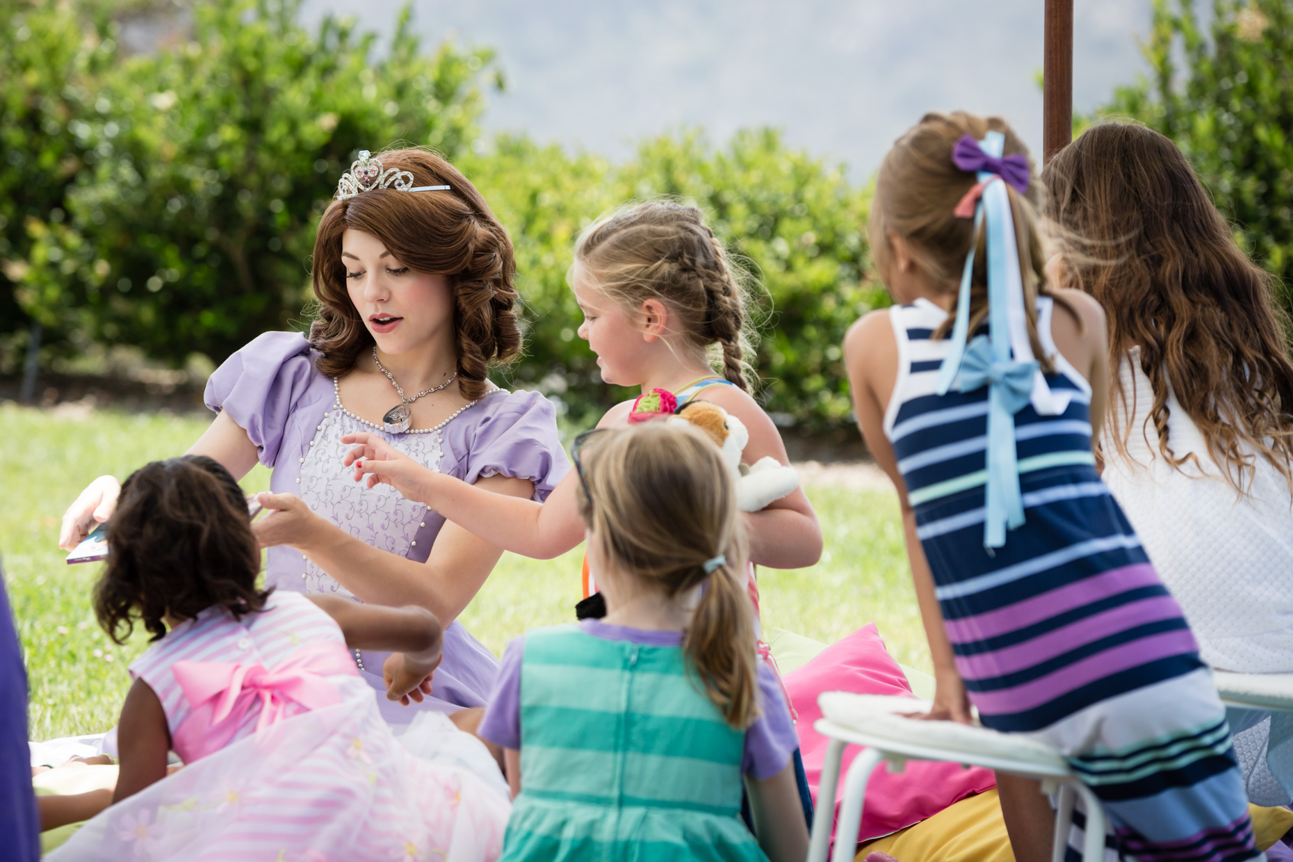 Princess Sofia impresses young children at a birthday party in Pacific Palisades, CA with her magic spells. Photo courtesy of  Drongo Photo .