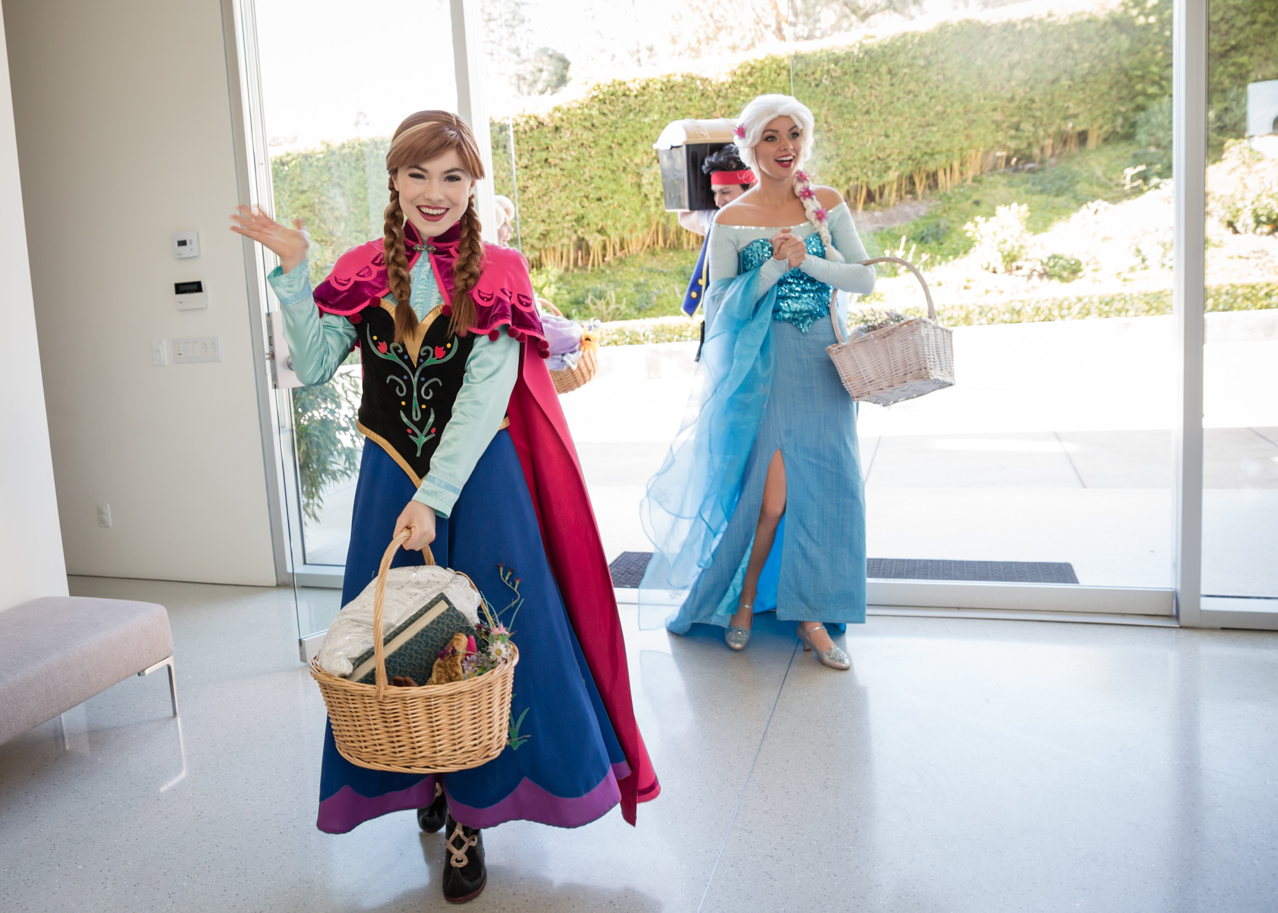 princess anna queen elsa make entrance at beverly hills party.jpg