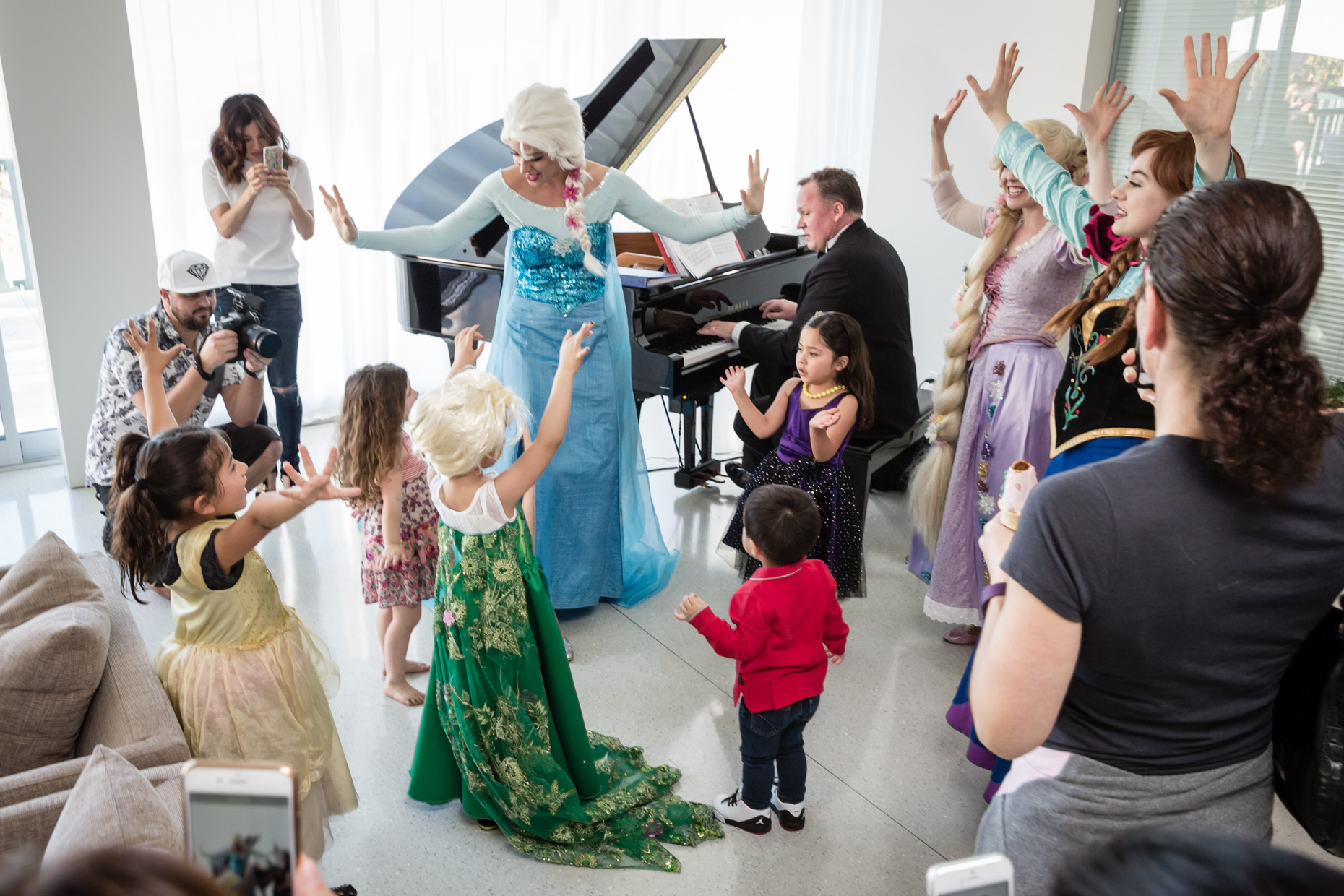singing and dancing with elsa anna rapunzel party characters beverly hills.jpg