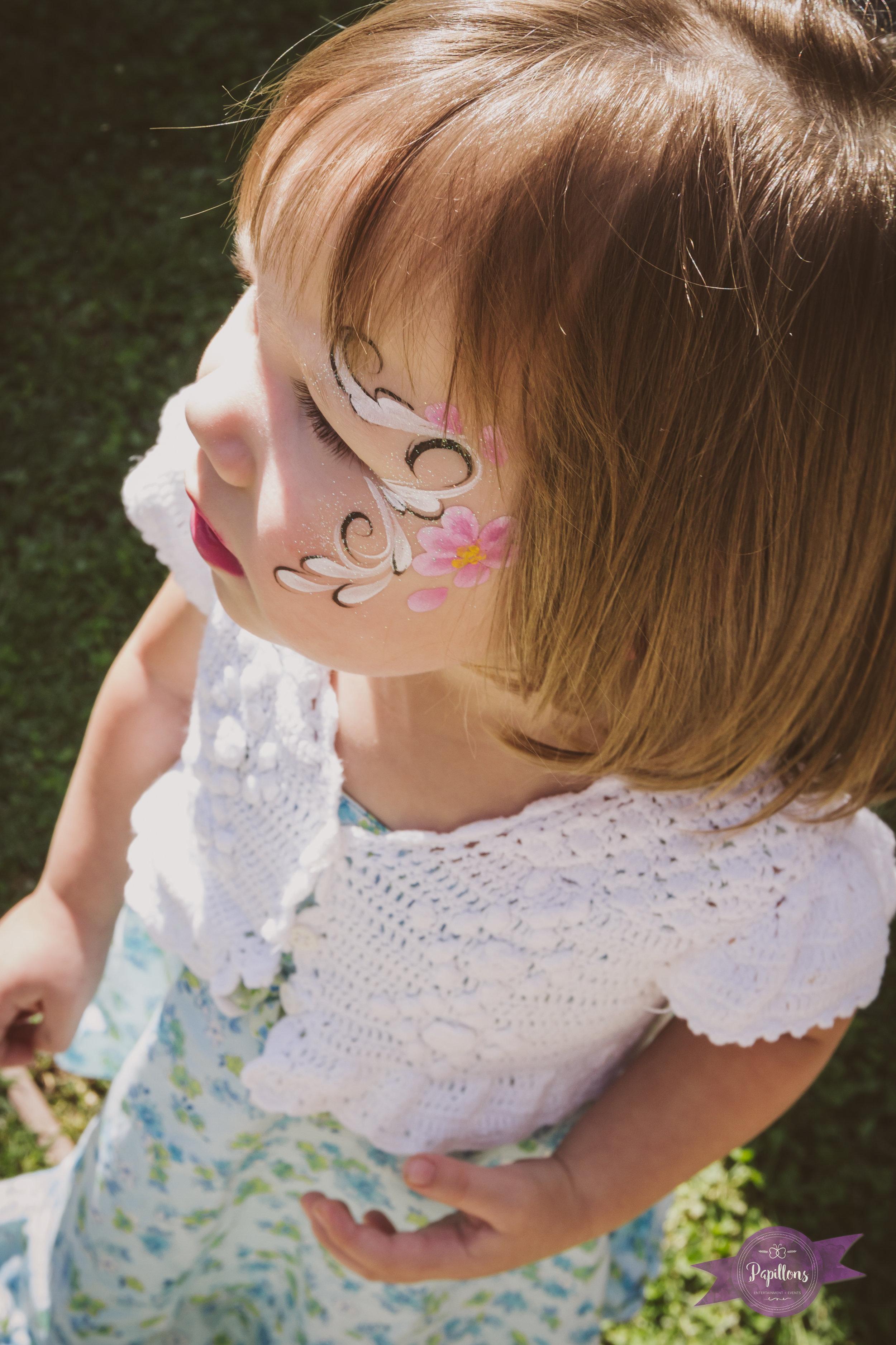 leo safari party guest flower face paint.jpg
