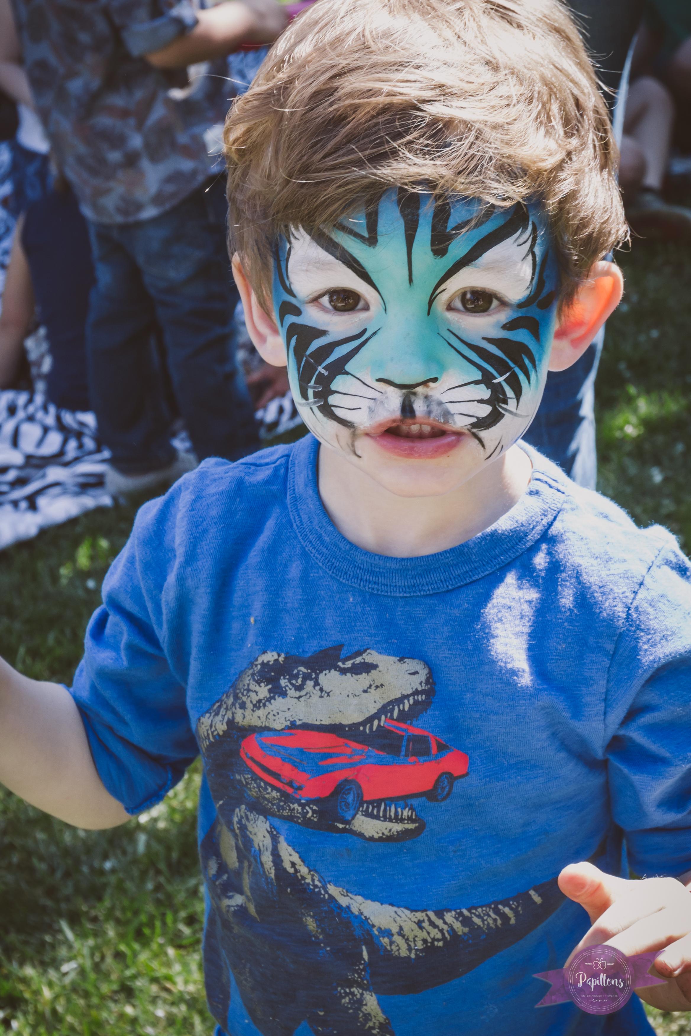 leo safari party colin jungle cat face paint.jpg