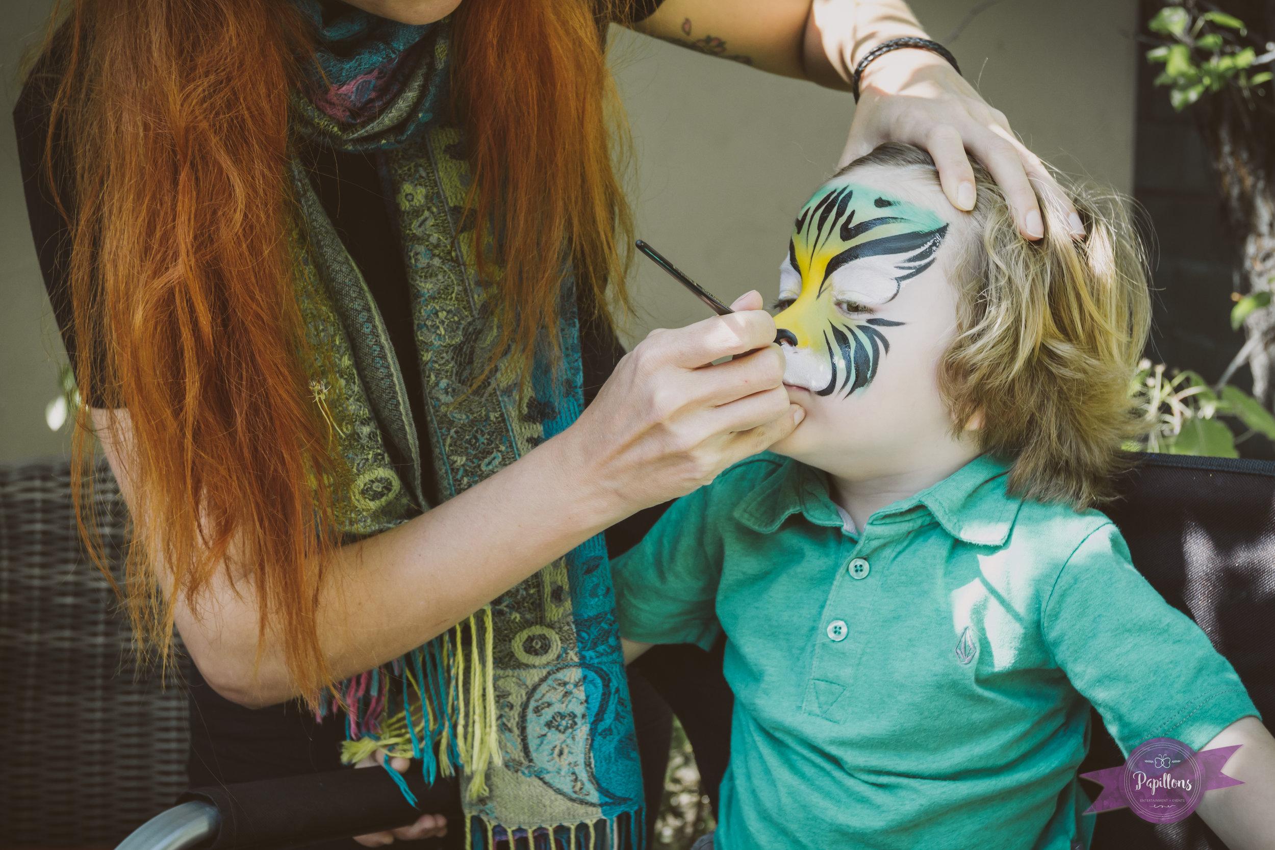 leo safari party guest jungle cat face paint.jpg