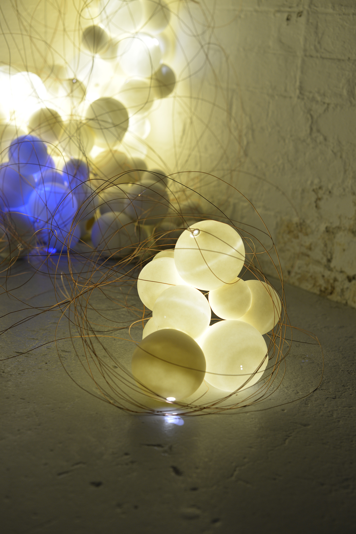 Intertwined_Dimension Variable_ Porcelain, LED lights, Wires_Leana Kim.jpg