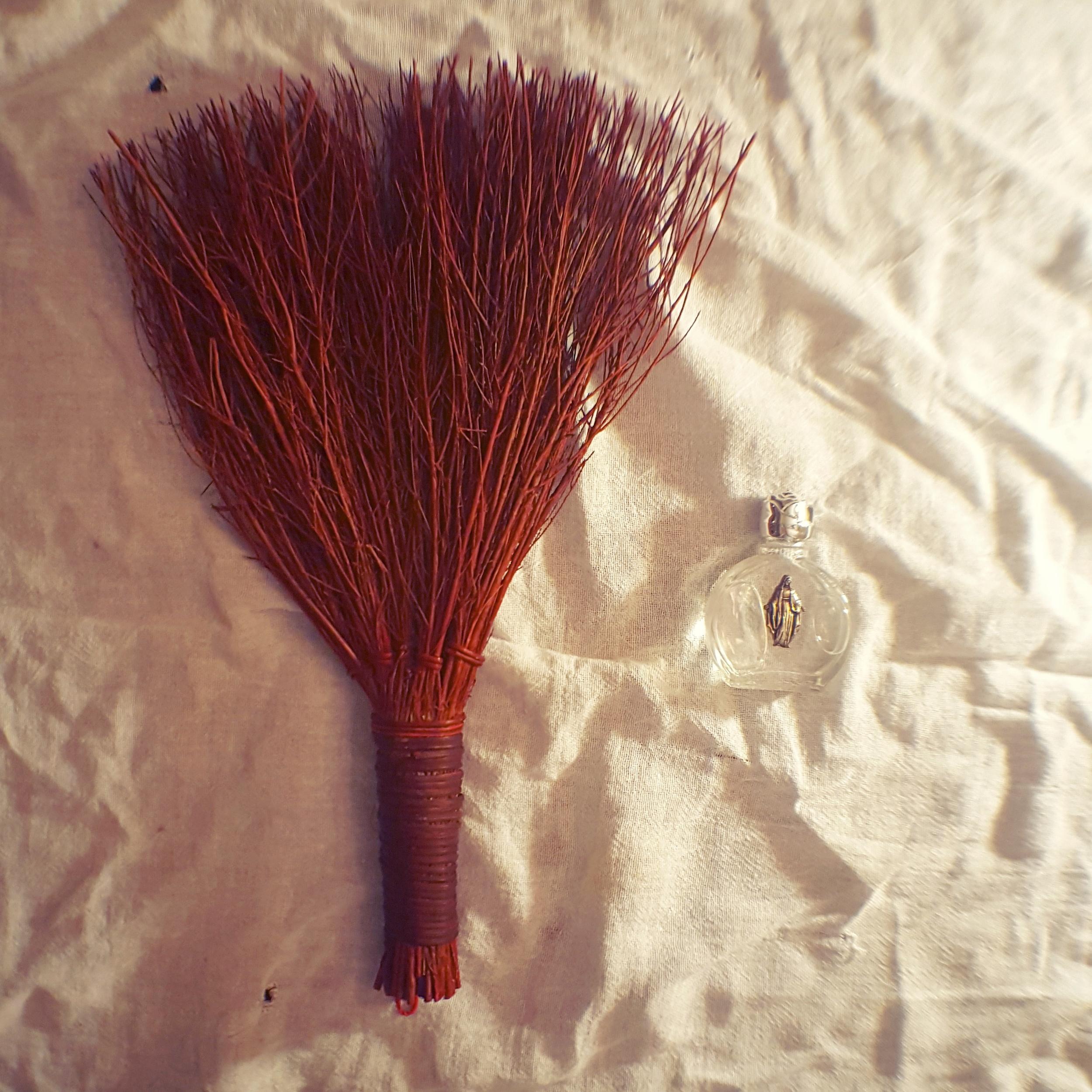 Aura-sweeping broom & holy water.
