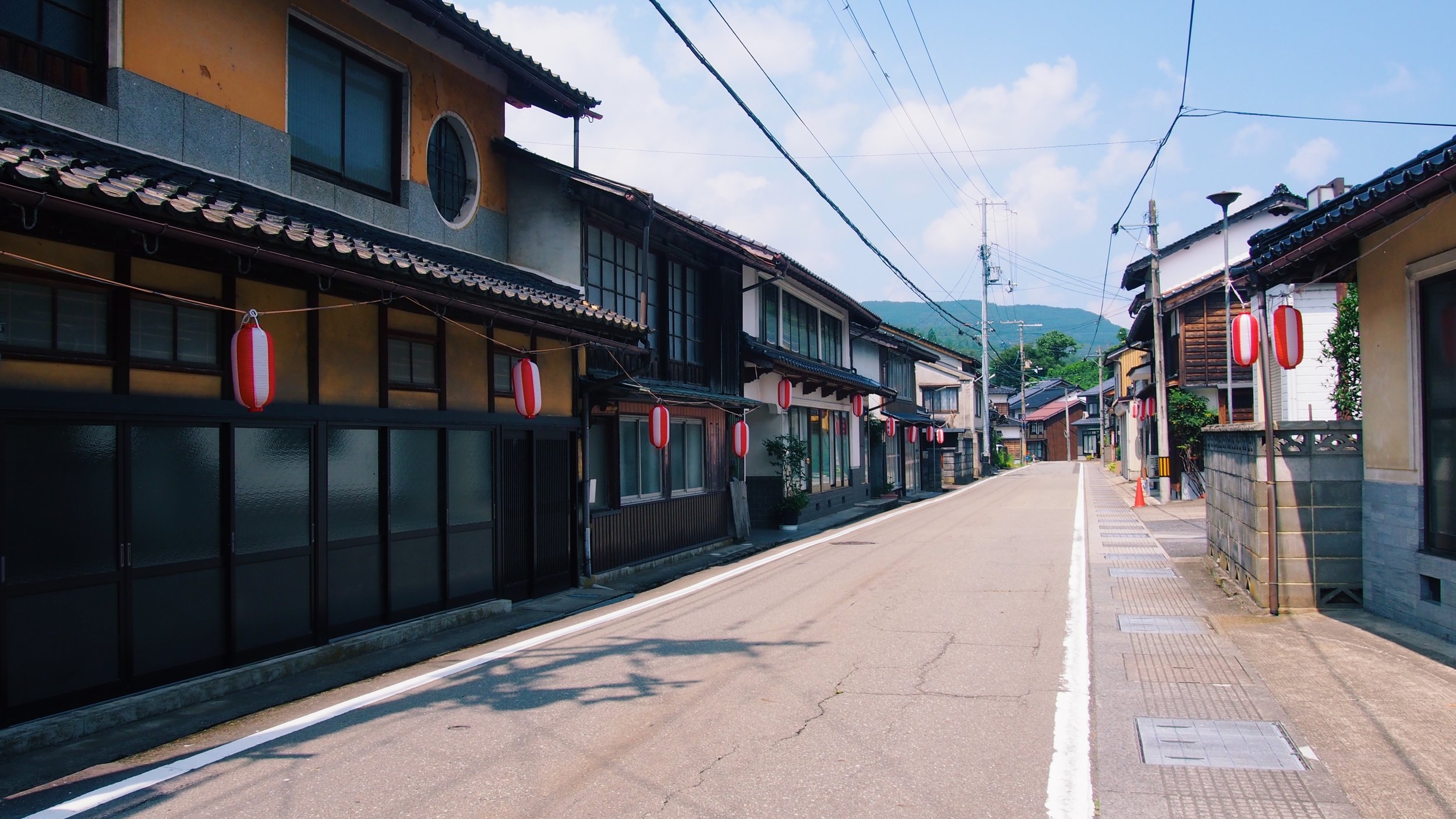 Japanese rural village street lined with summer festival lanters