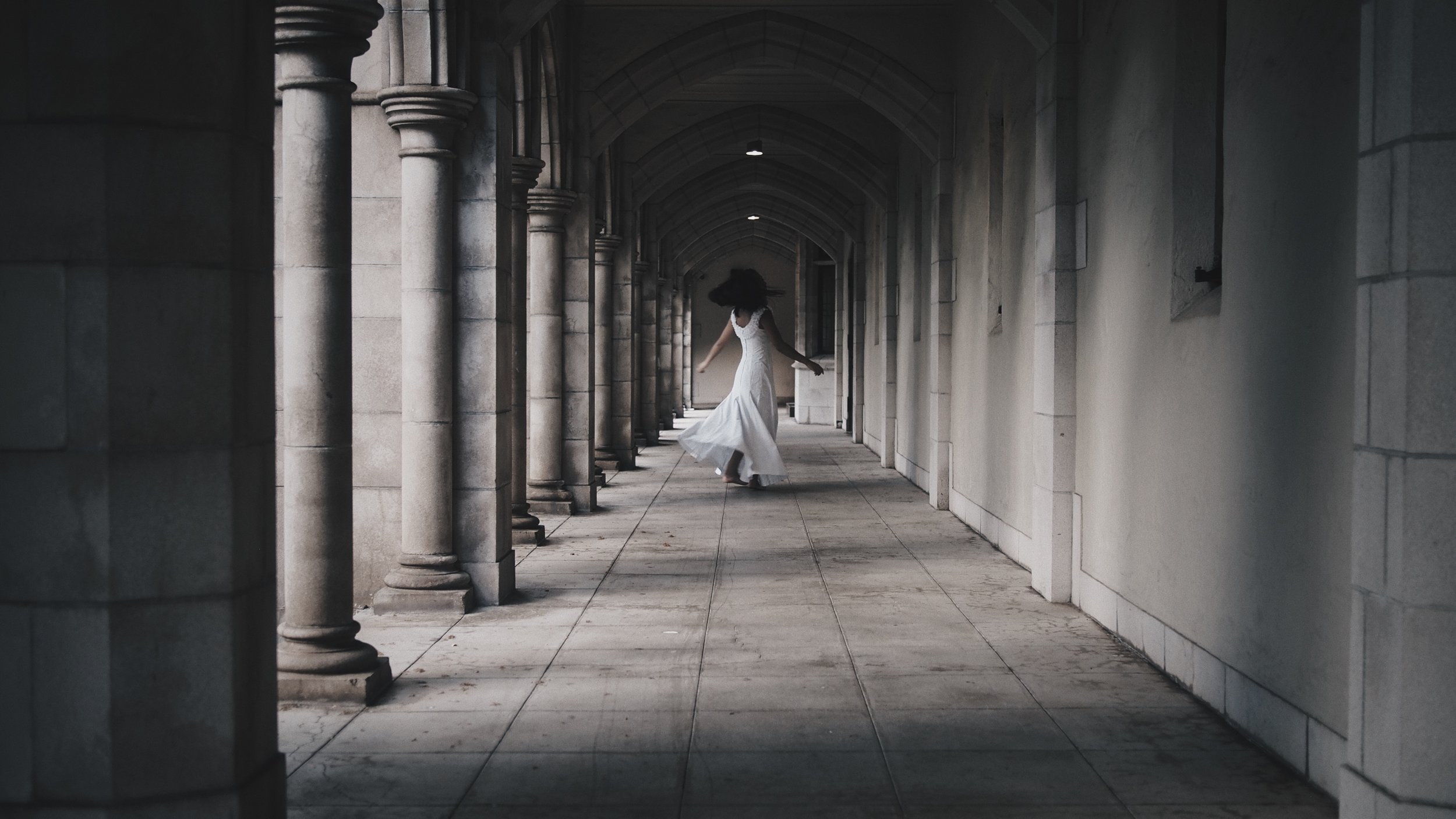 An eerie, ghostly image of a girl in a white dress