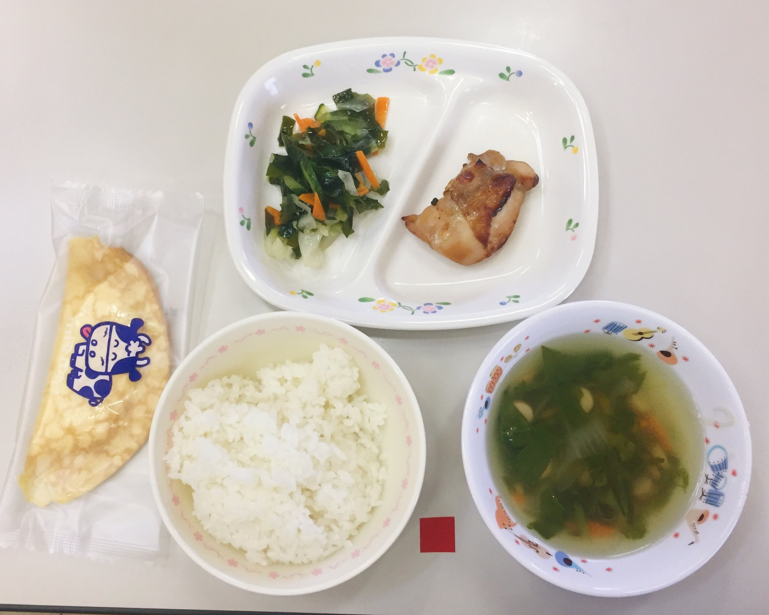Teriyaki chicken, pickled seaweed salad, seaweed soup, white rice, and a crepe - Dessert is included in lunch roughly once per month as well as around holidays