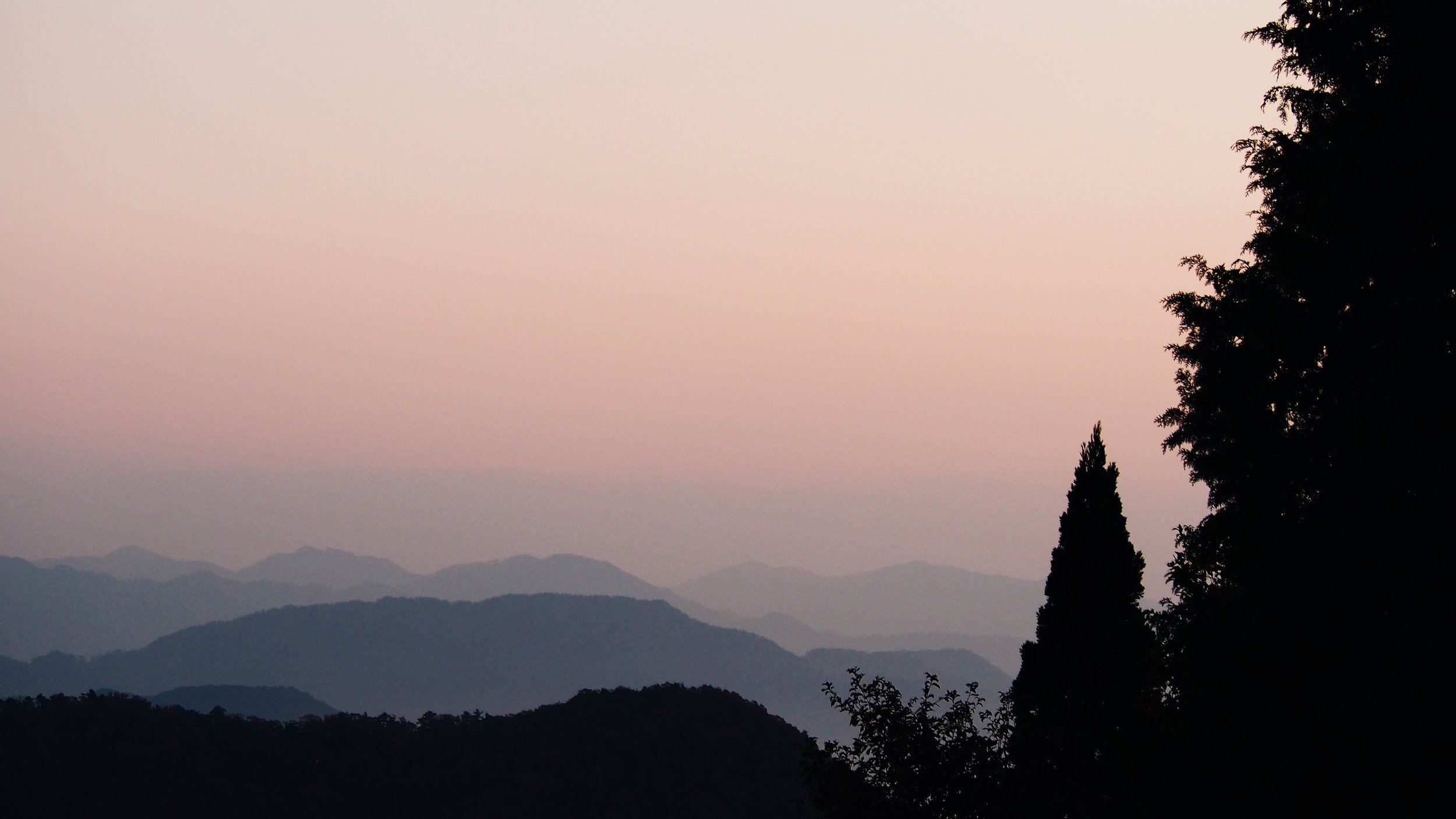 Mountains in the distance in the early morning sunrise light