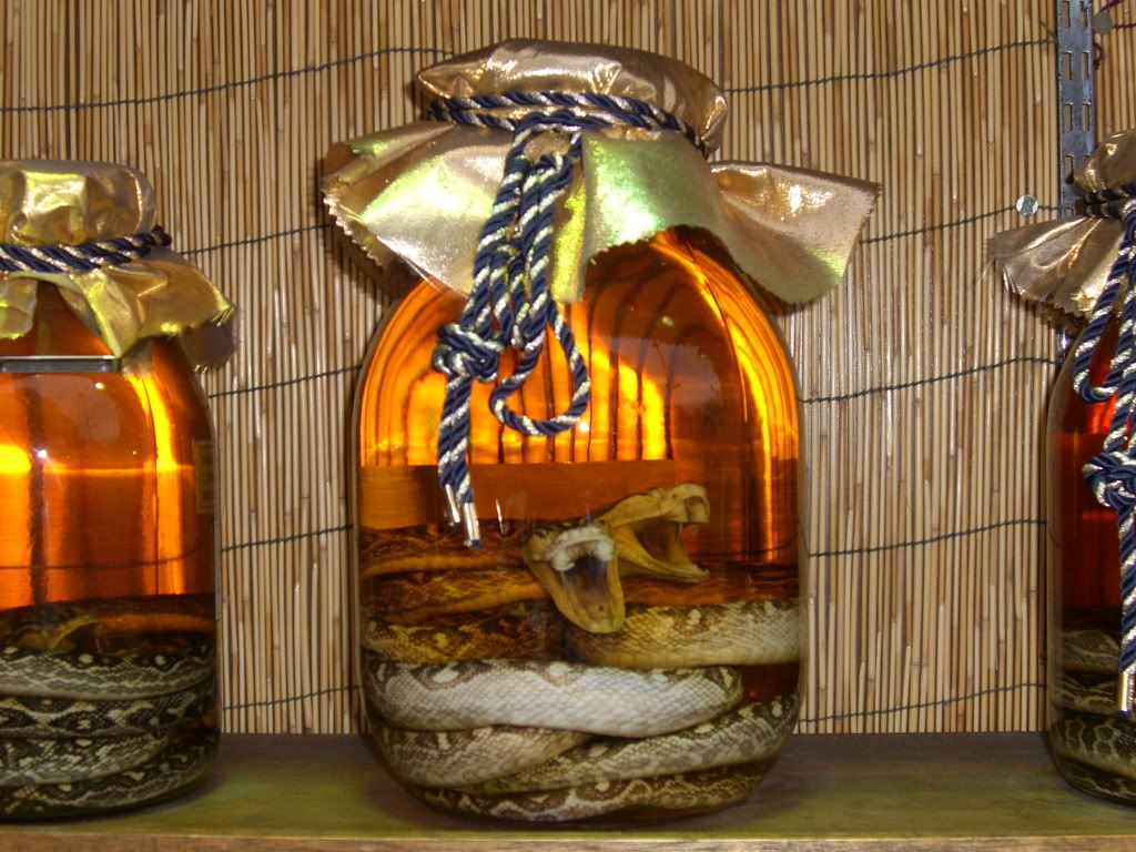 I've never tried it, but this is the stuff you can't import. It's called   awamori  . Photo from  https://fluffykat.wordpress.com
