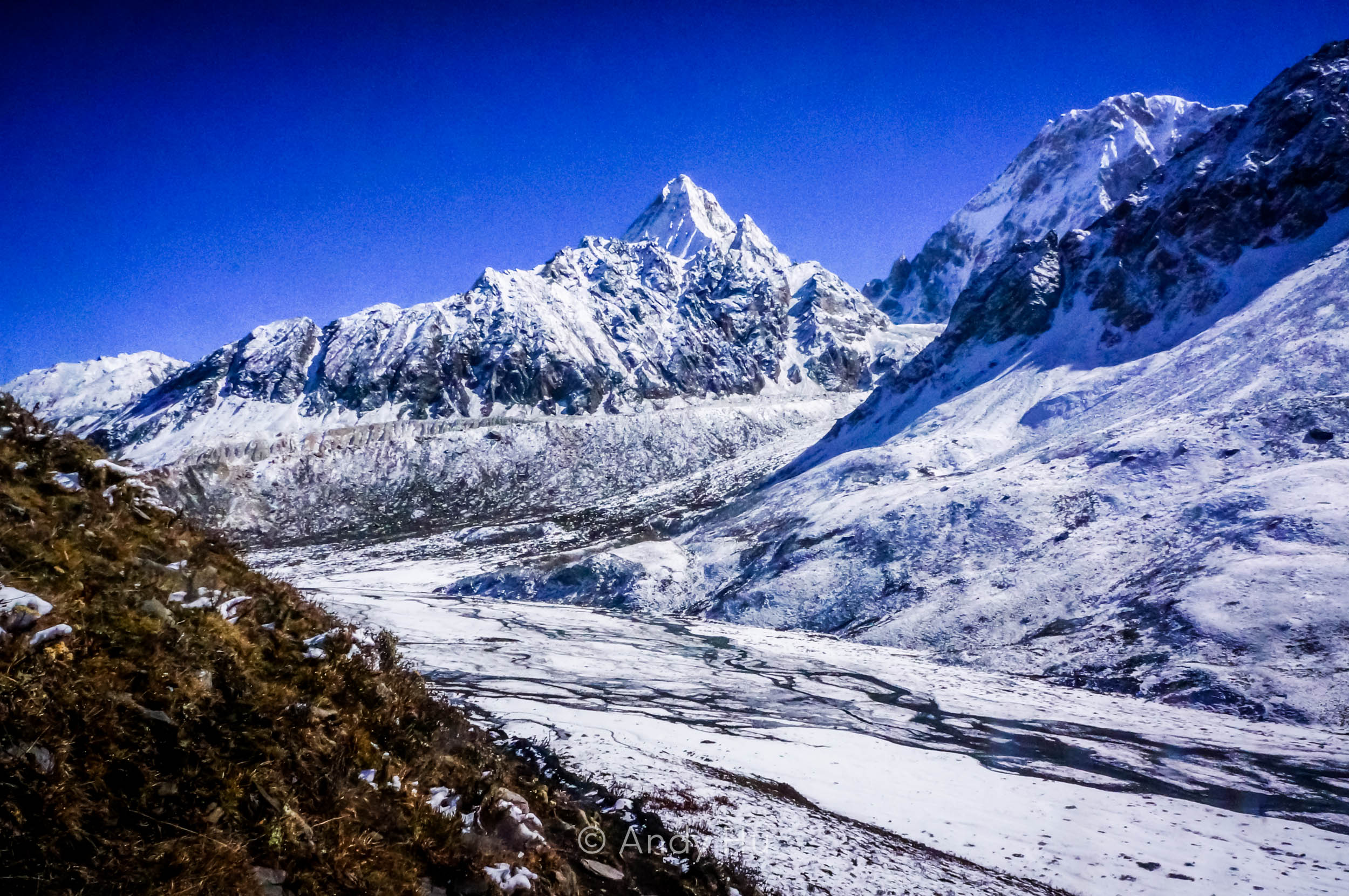 Snow-capped peaks and frozen river from Riwoche pass, day 2 Mt. Gongga Trek