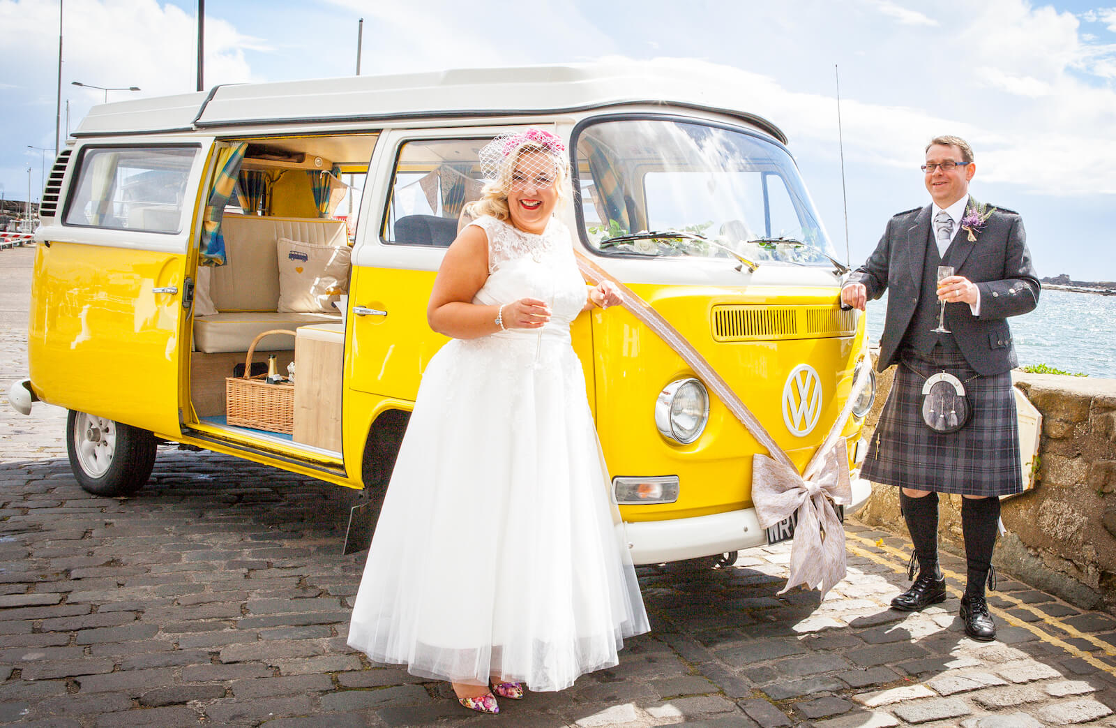 LITTLE MISS SUNSHINE   The yellow VW camper van. LHD with wedge shaped pop up roof. Available chauffeur driven as your wedding car. Seats 6 passengers, 1 driver.