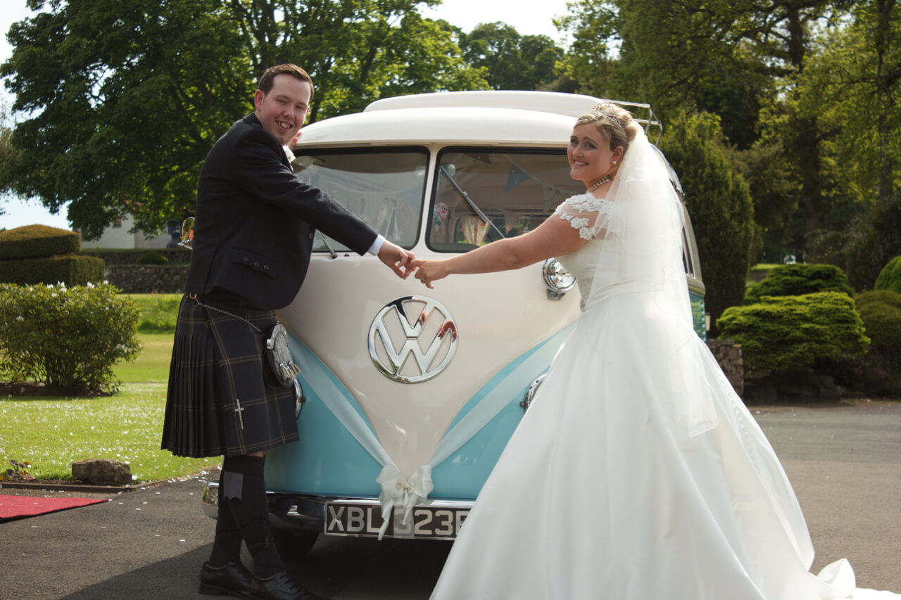 Our VW camper wedding car outside Kilconquhar with a newly wed couple