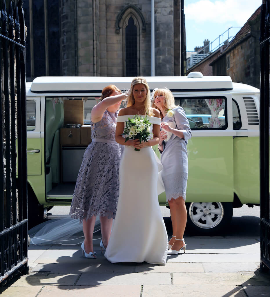 Bride arriving at St Andrews university in Moomin our VW camper wedding car