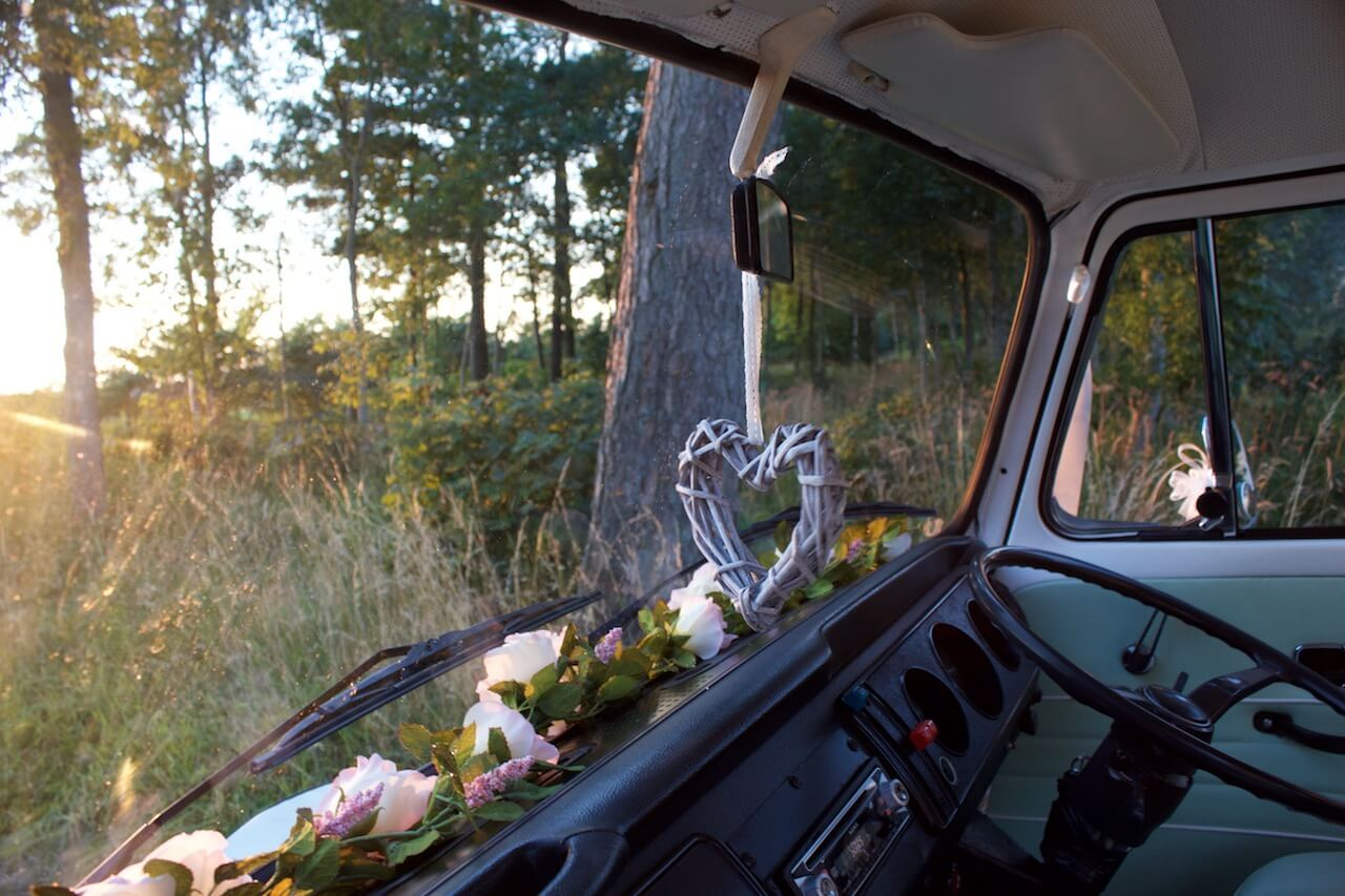 Side view of our VW camper wedding car - Moomin with lavender bunches in the door handles