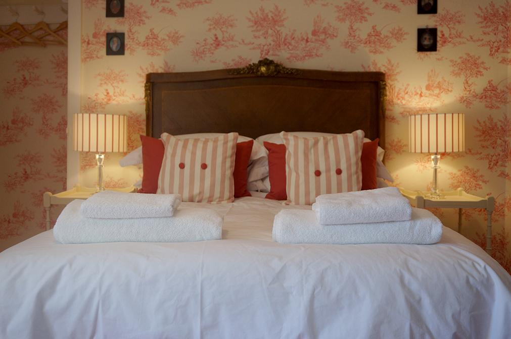 Luxury accommodation at wedding venue Pengenna Manor in Cornwall pink bedroom 04.jpg