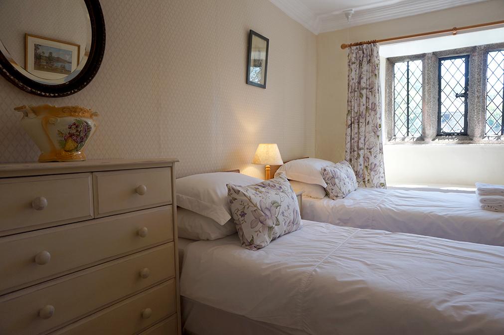 Luxury accommodation at wedding venue Pengenna Manor in Cornwall purple bedroom 01.jpg
