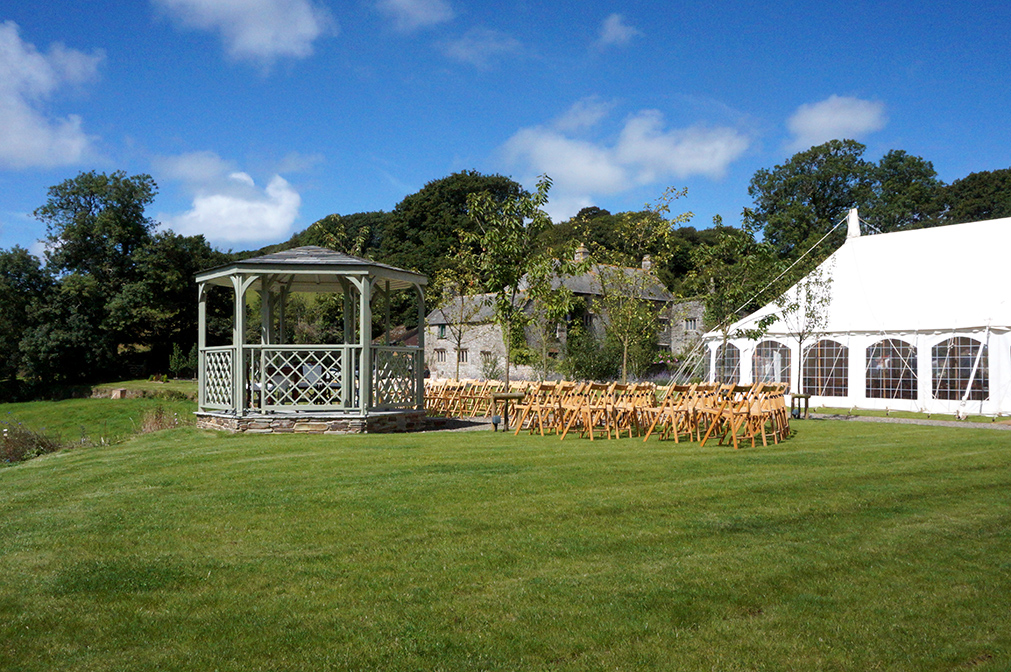 A marquee and outside wedding ceremony at wedding venue Pengenna Manor in Cornwall.jpg