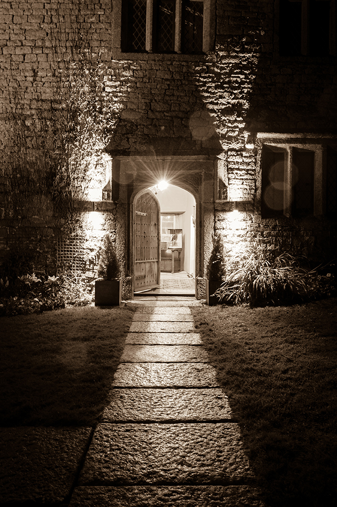 The front door of the Manor at night at wedding venue Pengenna Manor in Cornwall.jpg