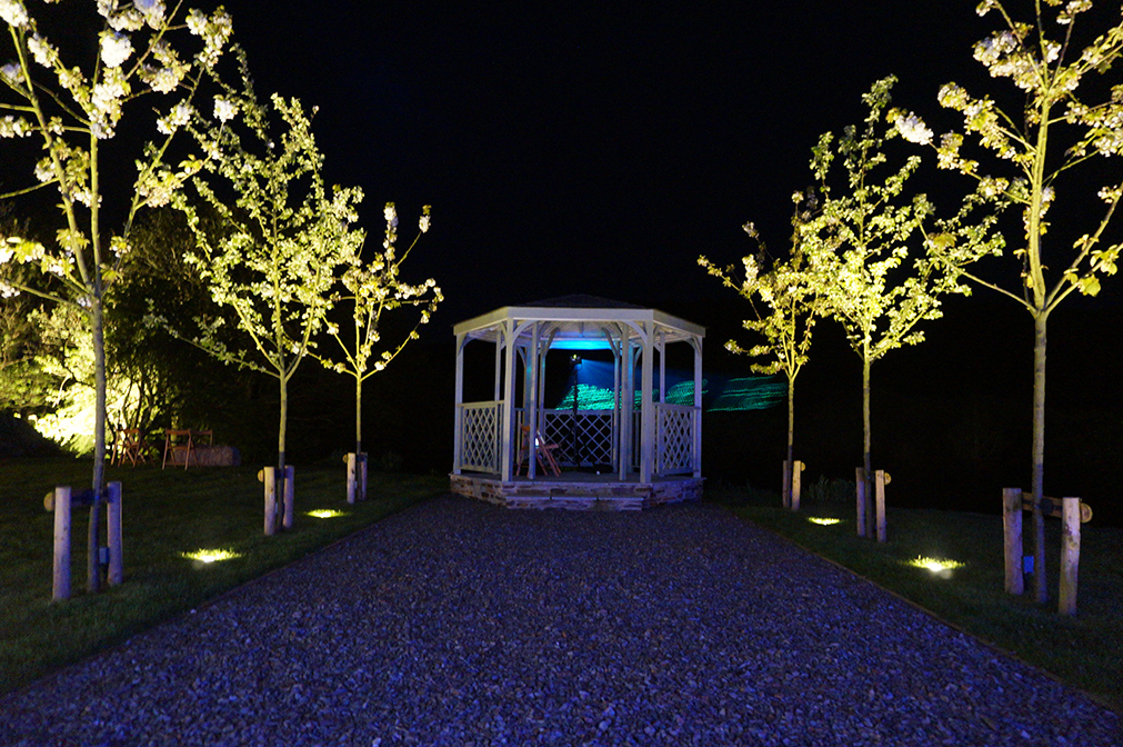 The outdoor wedding ceremony garden at night at wedding venue Pengenna Manor in Cornwall.jpg